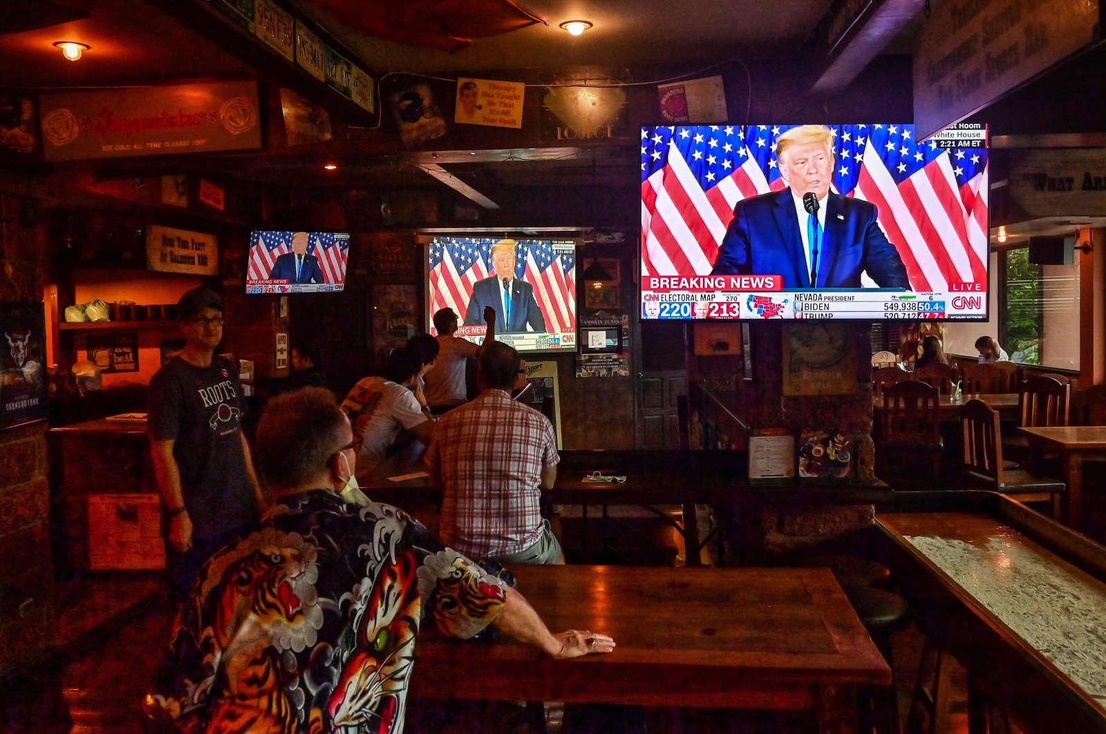 U.S. President Donald Trump speaks as Democratic Party supporters watch the vote count for the U.S. elections, in a restaurant in Bangkok, Thailand, Nov. 4, 2020. (AFP Photo)