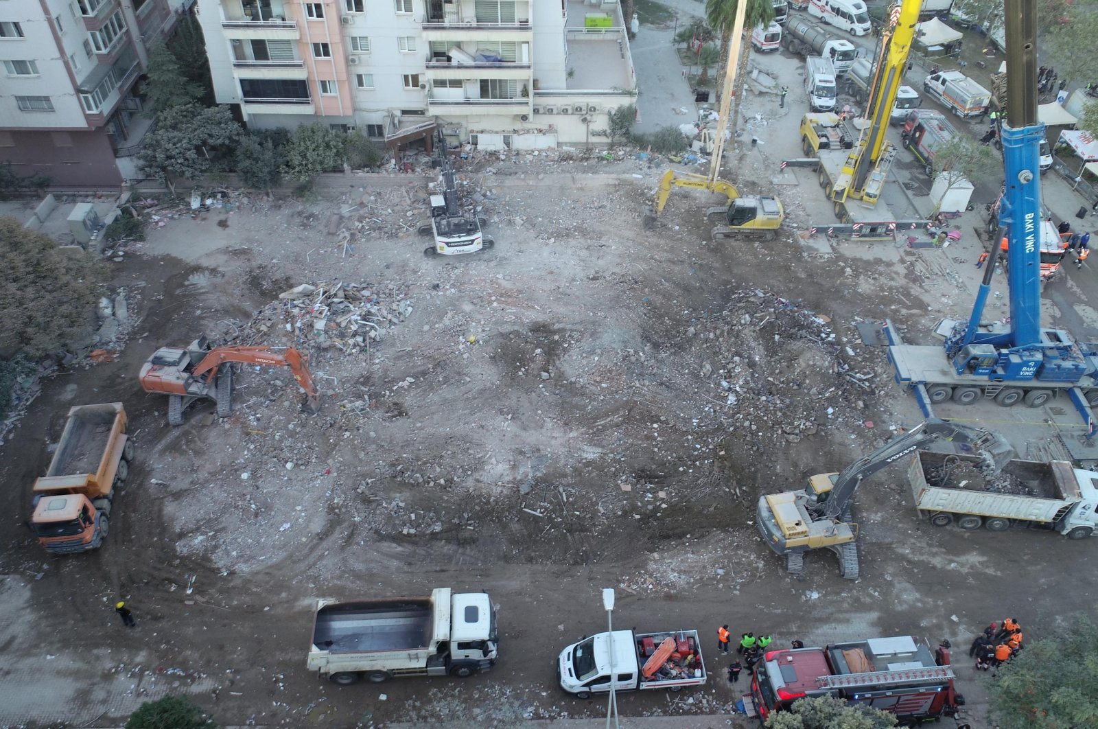 Bulldozers flatten the area where an apartment building collapsed in the earthquake once stood, in Izmir, Turkey, Nov. 4, 2020. (DHA Photo)