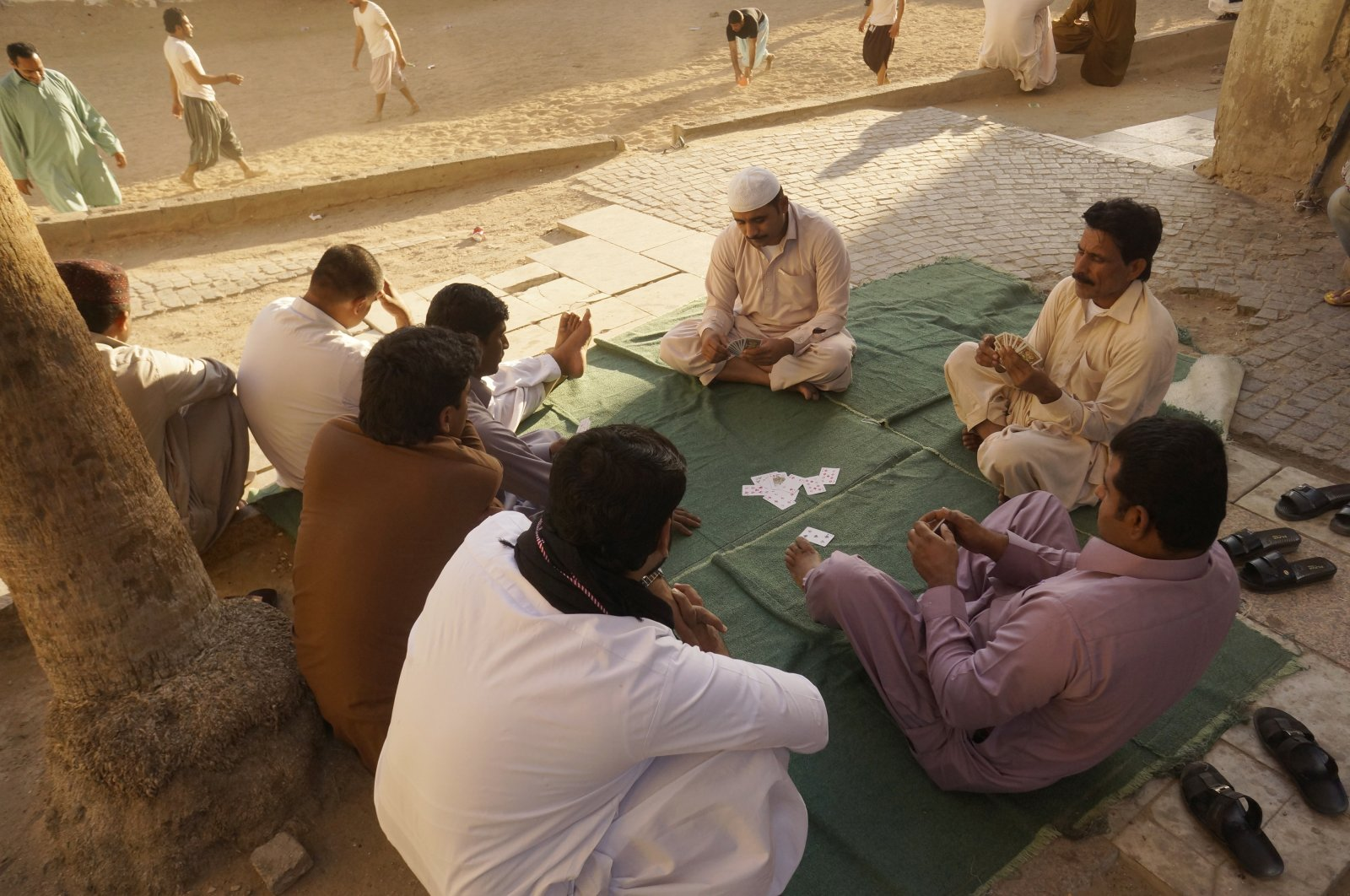 Workers play cards during their holiday in the Old City of Jiddah, Saudi Arabia, Jan. 24, 2020 (AP Photo)