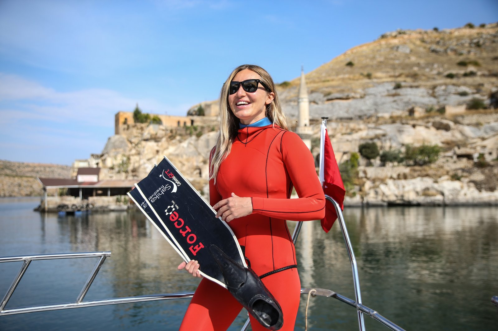 Şahika Ercümen dived into the waters of Halfeti in Şanlıurfa as part of her collaboration with the UNDP on solid waste management on Nov. 4, 2020. (AA Photo)