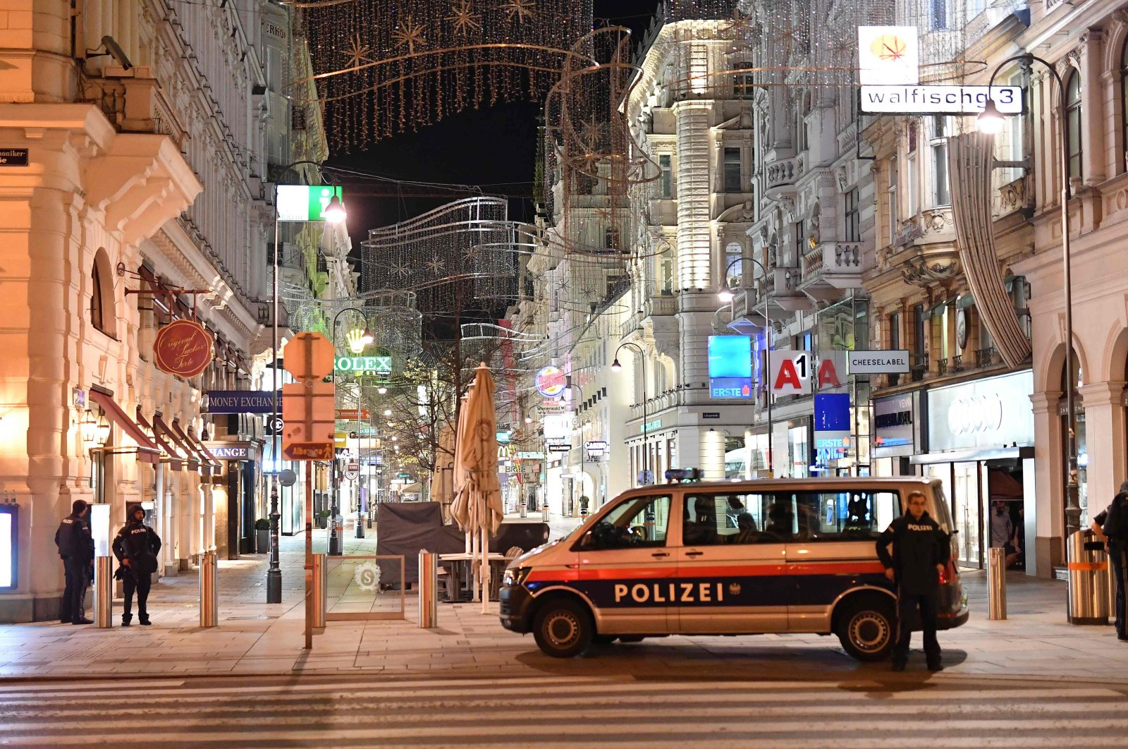 Armed policemen stand guard in a shopping street in the center of Vienna, following a shooting, Austria, Nov. 2, 2020. (AFP PHoto)