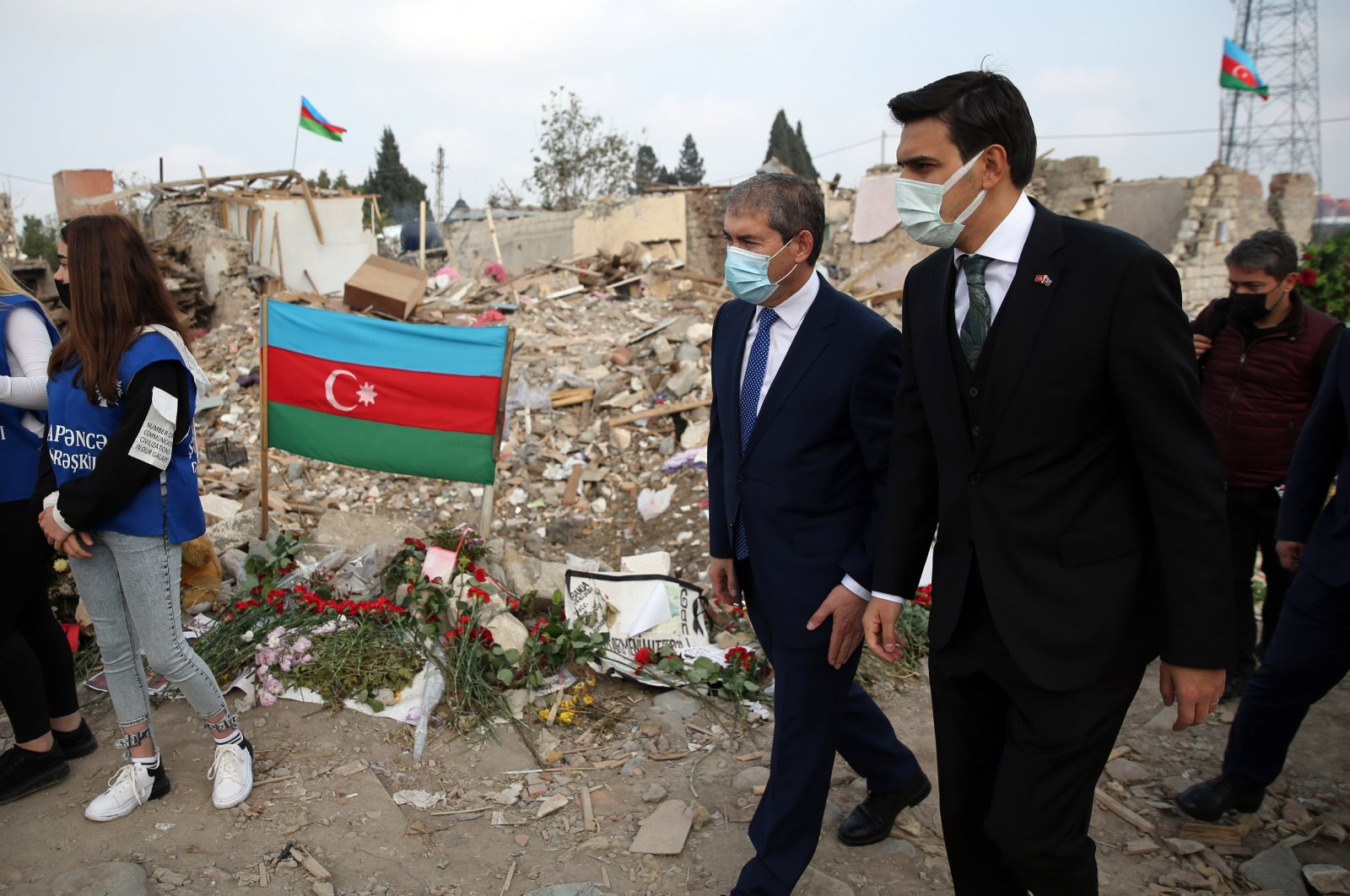 Abdullah Eren (R), the chair of Presidency for Turks Abroad and Related Communities (YTB), visits the wreckage of a building destroyed by an Armenian shelling in the Azerbaijani city of Ganja, Nov. 4, 2020. (AA Photo)