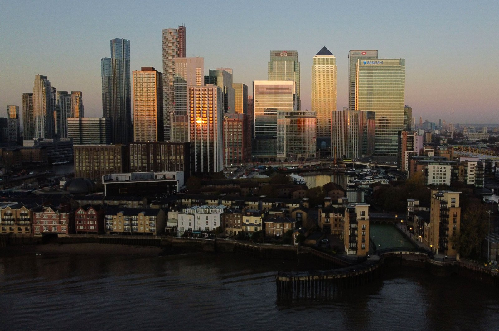 An aerial view of London's Canary Wharf financial district as the sun rises over the River Thames in London on Nov. 4, 2020. (AFP Photo)
