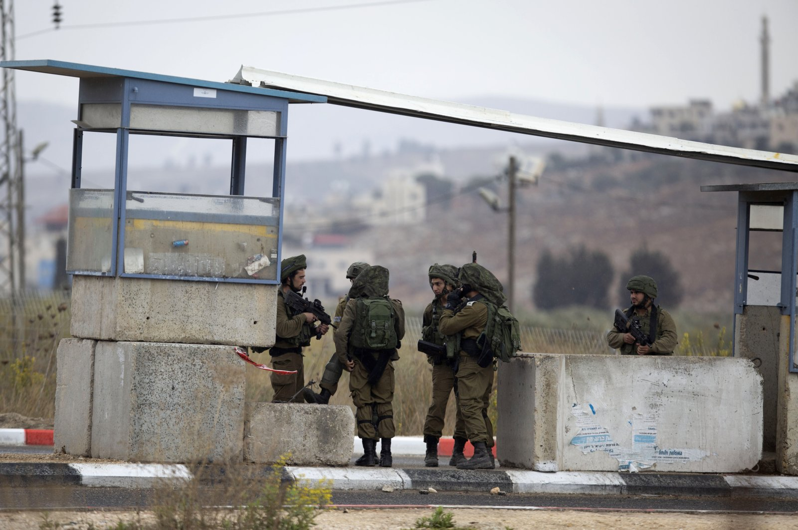 Israeli soldiers secure the area at the Huwara checkpoint south of the West Bank city of Nablus, Nov. 4, 2020. (AP Photo)