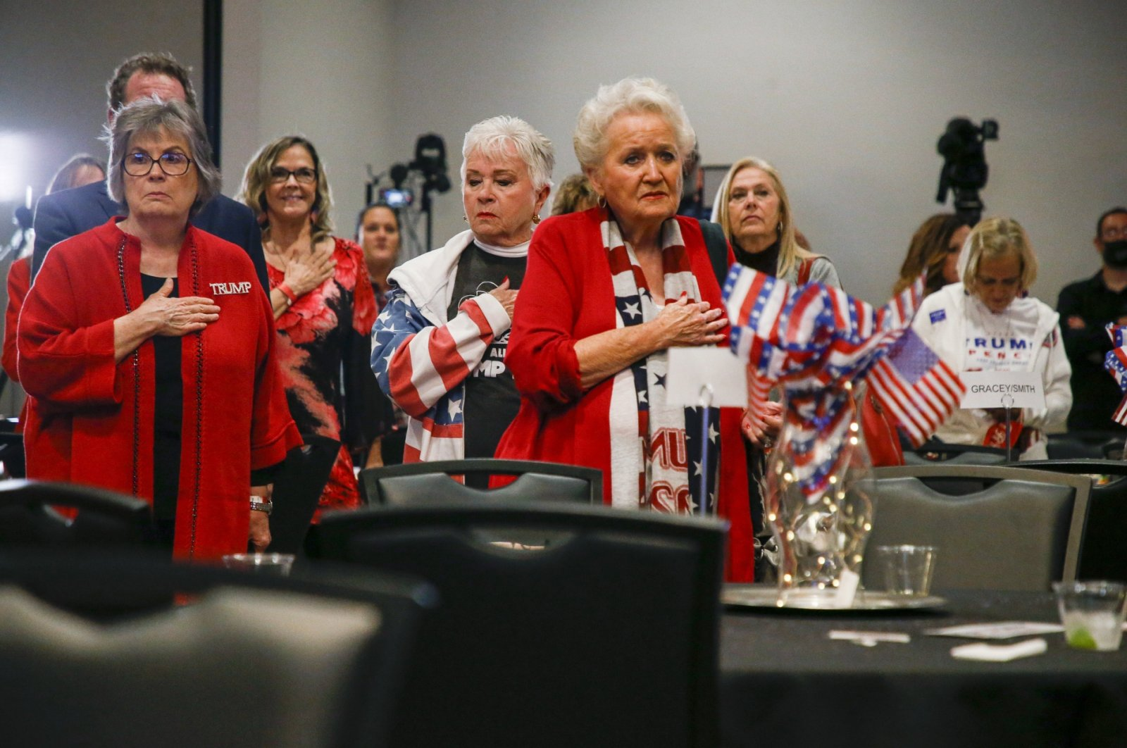 Supporters of President Donald Trump stand during the national anthem at an election results watch party sponsored by the Oklahoma Republican Party in Tulsa, Oklahoma, U.S., Nov. 3, 2020. (AP Photo)
