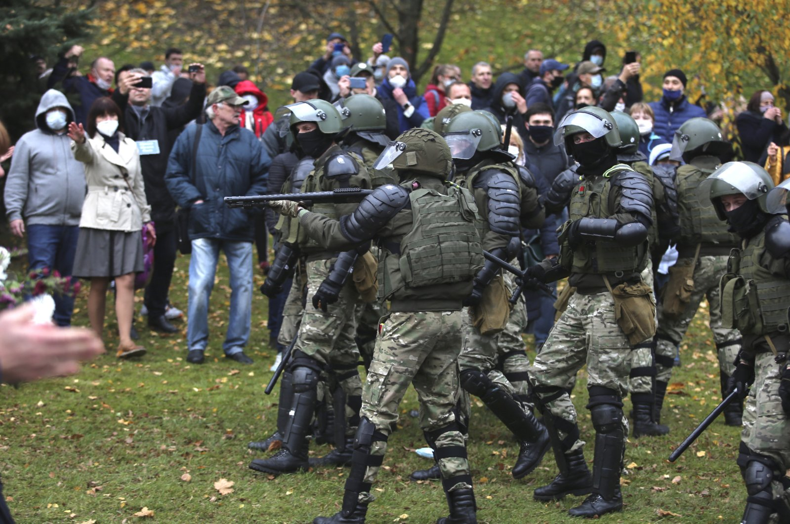 People argue with policemen during an opposition rally to protest the official presidential election results in Minsk, Belarus, Nov. 1, 2020. (AP Photo)