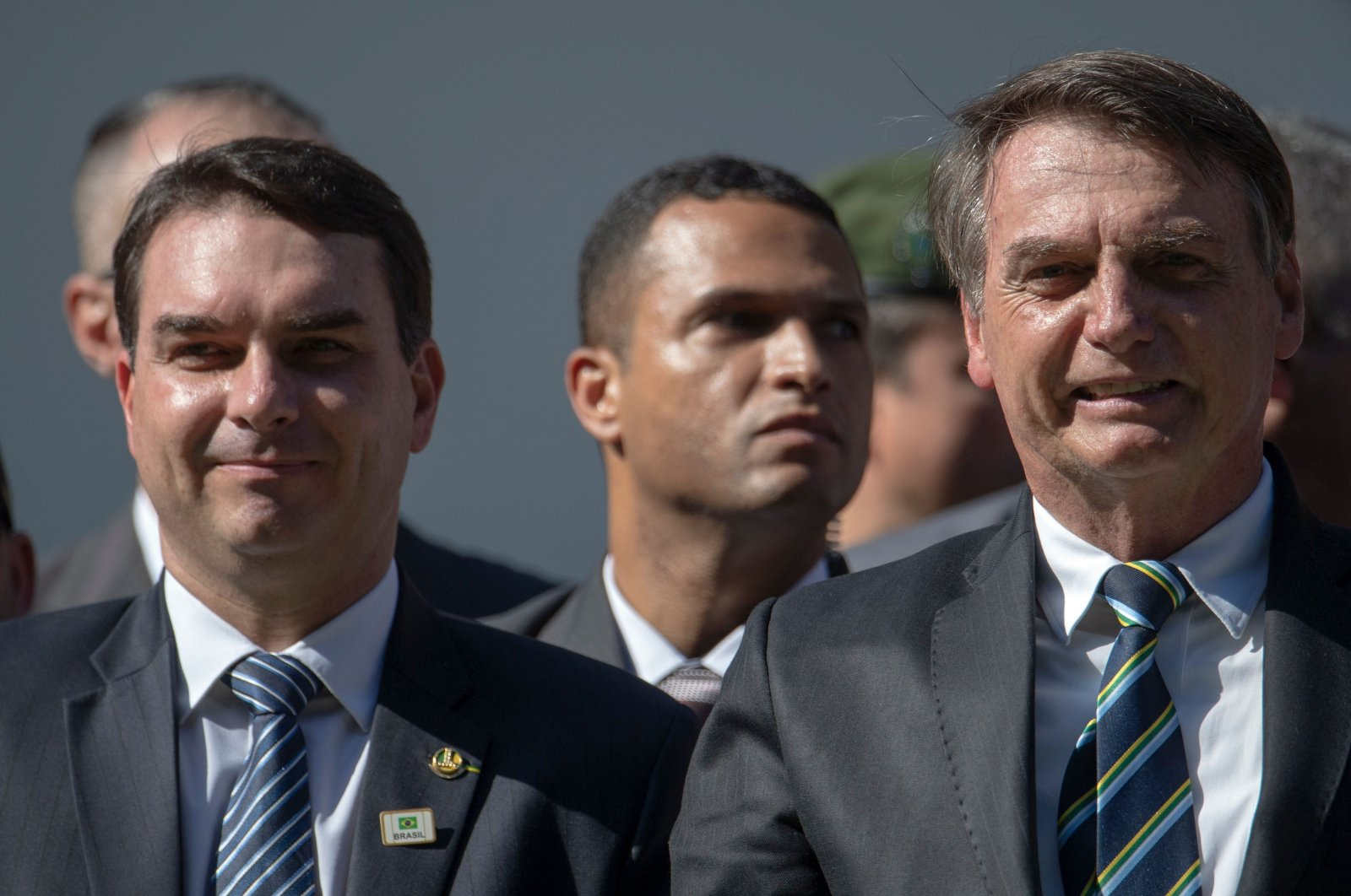Brazilian President Jair Bolsonaro (R) and his son Flavio Bolsonaro attend a ceremony marking the 130th anniversary of the Rio de Janeiro Military School (CMRJ), in Rio de Janeiro, Brazil, May 6, 2019. (AFP Photo)