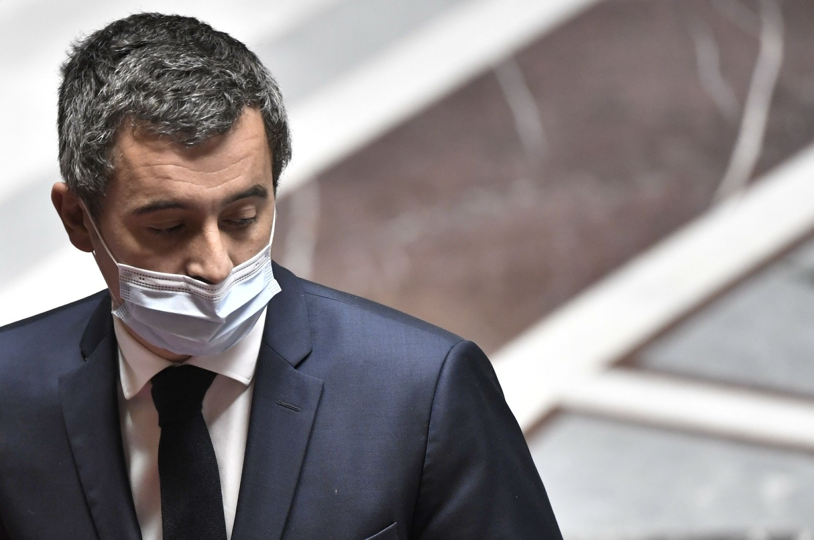 French Interior Minister Gerald Darmanin looks over during a session of questions to the government at the French National Assembly in Paris, France, Nov. 3, 2020. (AFP Photo)
