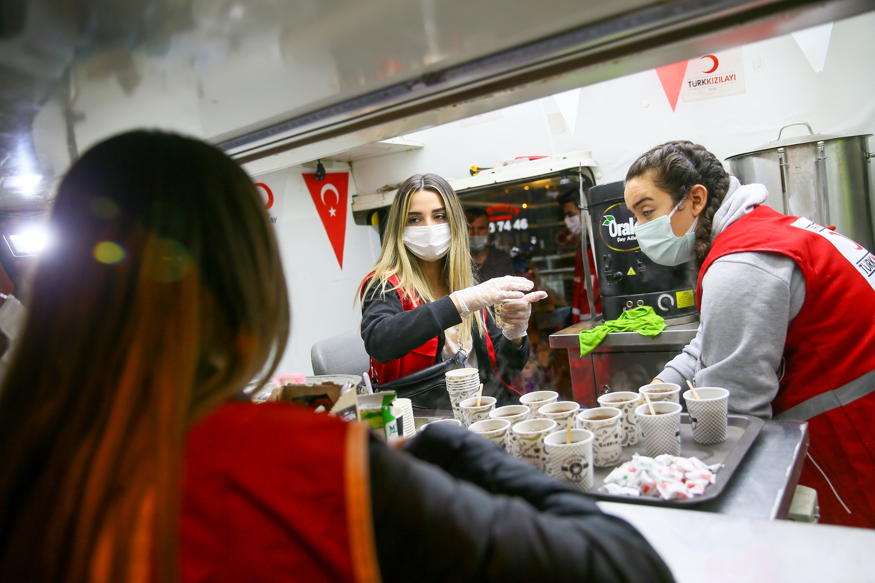 A group of women, nicknamed the Aid Angels, volunteer to help the Turkish Red Crescent (Kızılay) serve hot meals to earthquake victims in Izmir, Turkey, Nov. 4, 2020. (AA Photo)