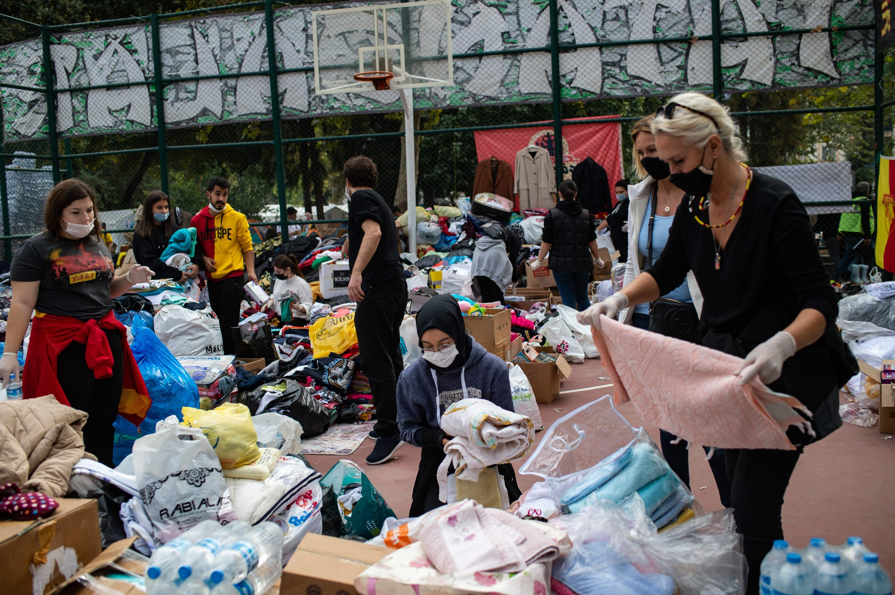 Food and clothing aid for survivors are collected at a basketball court in the city of Izmir after an earthquake struck the coastal province of Izmir, Turkey, Nov. 3, 2020. (AFP Photo)