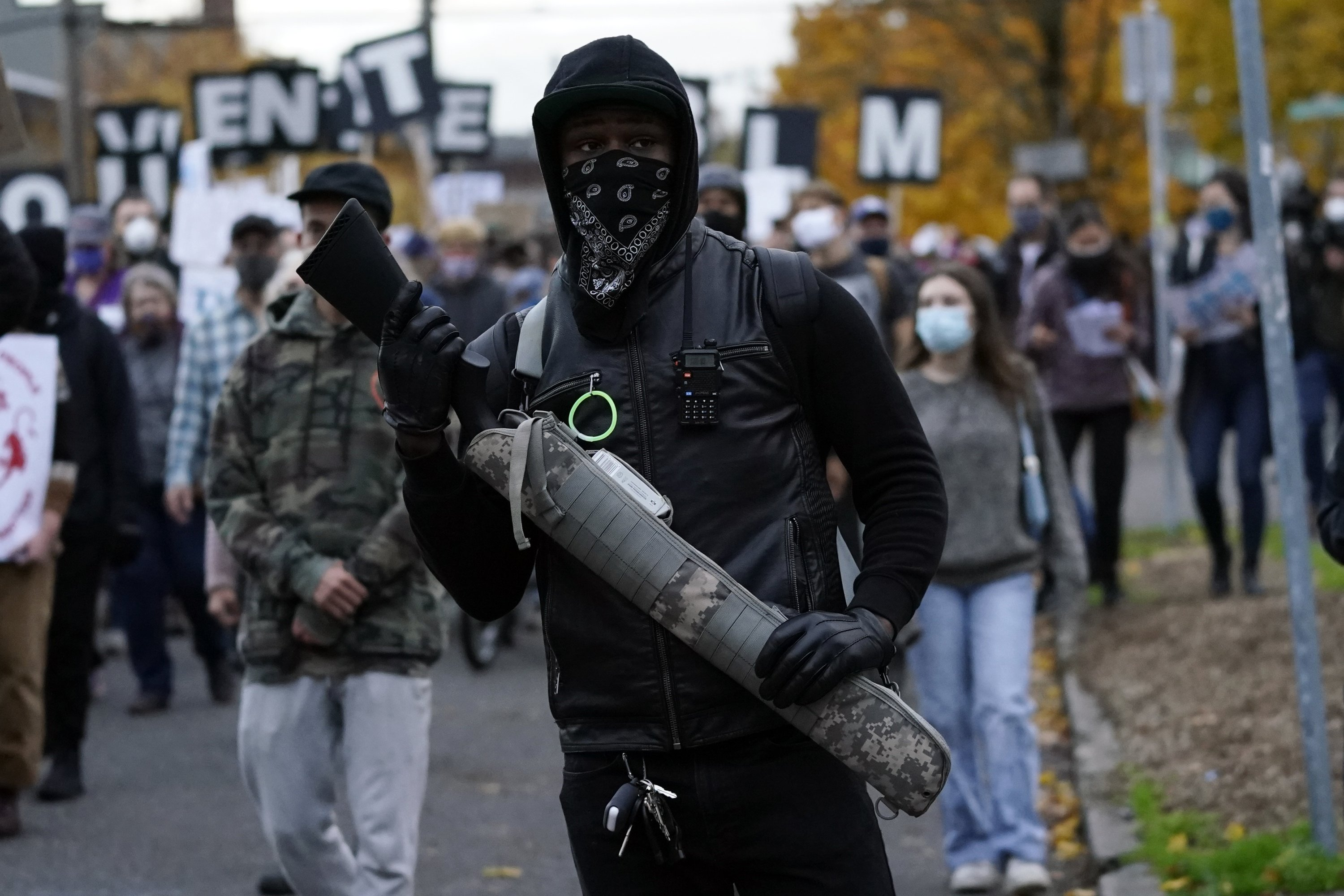 A man carries a gun as he walks during a march in support of vote-counting after the Nov. 3 elections, Portland, Oregon, U.S., Nov. 4, 2020. (AP Photo)