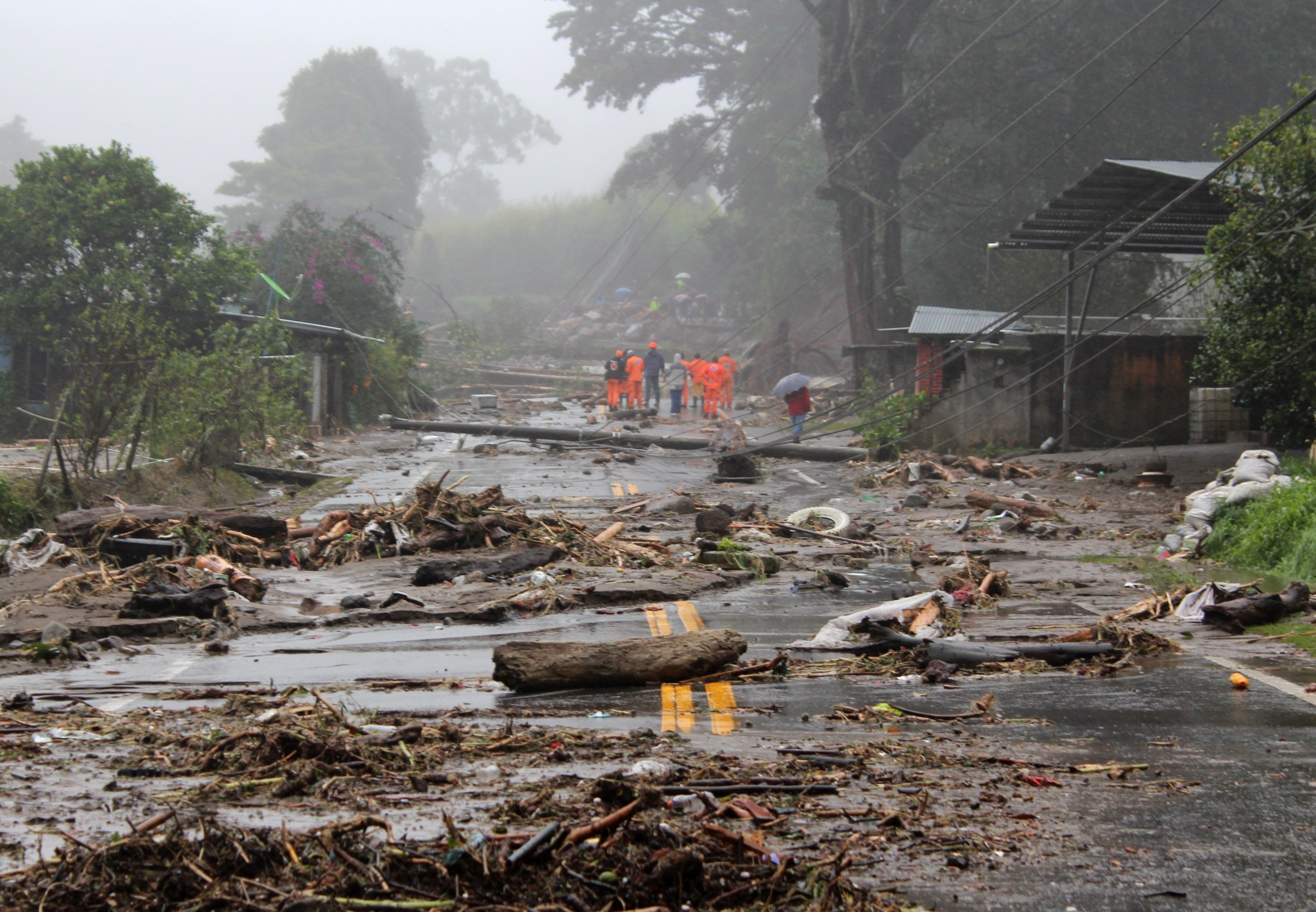 Inhabitants walk through a damaged road after heavy rains associated with the passage of Tropical Depression Eta hit Central America in Chiriqui, Panama, Nov. 5, 2020. (EPA Photo)
