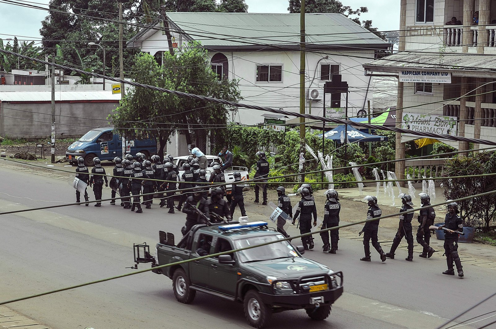 Cameroon police officials with riot equipment patrol along a street in the administrative quarter of Buea some 60 kilometers (37.2 miles) west of Douala on Oct. 1, 2017. (AFP Photo)