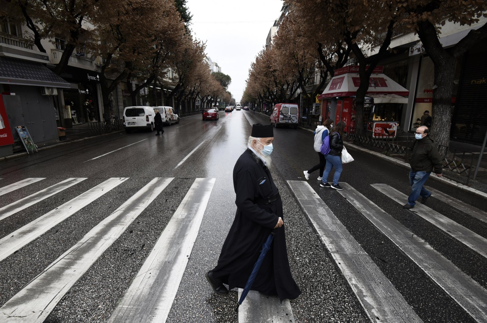 A Greek orthodox priest wearing a face mask to protect against the spread of the coronavirus, walks during the lockdown to contain the spread of COVID-19, on Tsimiski Street, Thessaloniki's main shopping area, northern Greece, Tuesday, Nov. 3, 2020. (AP Photo)