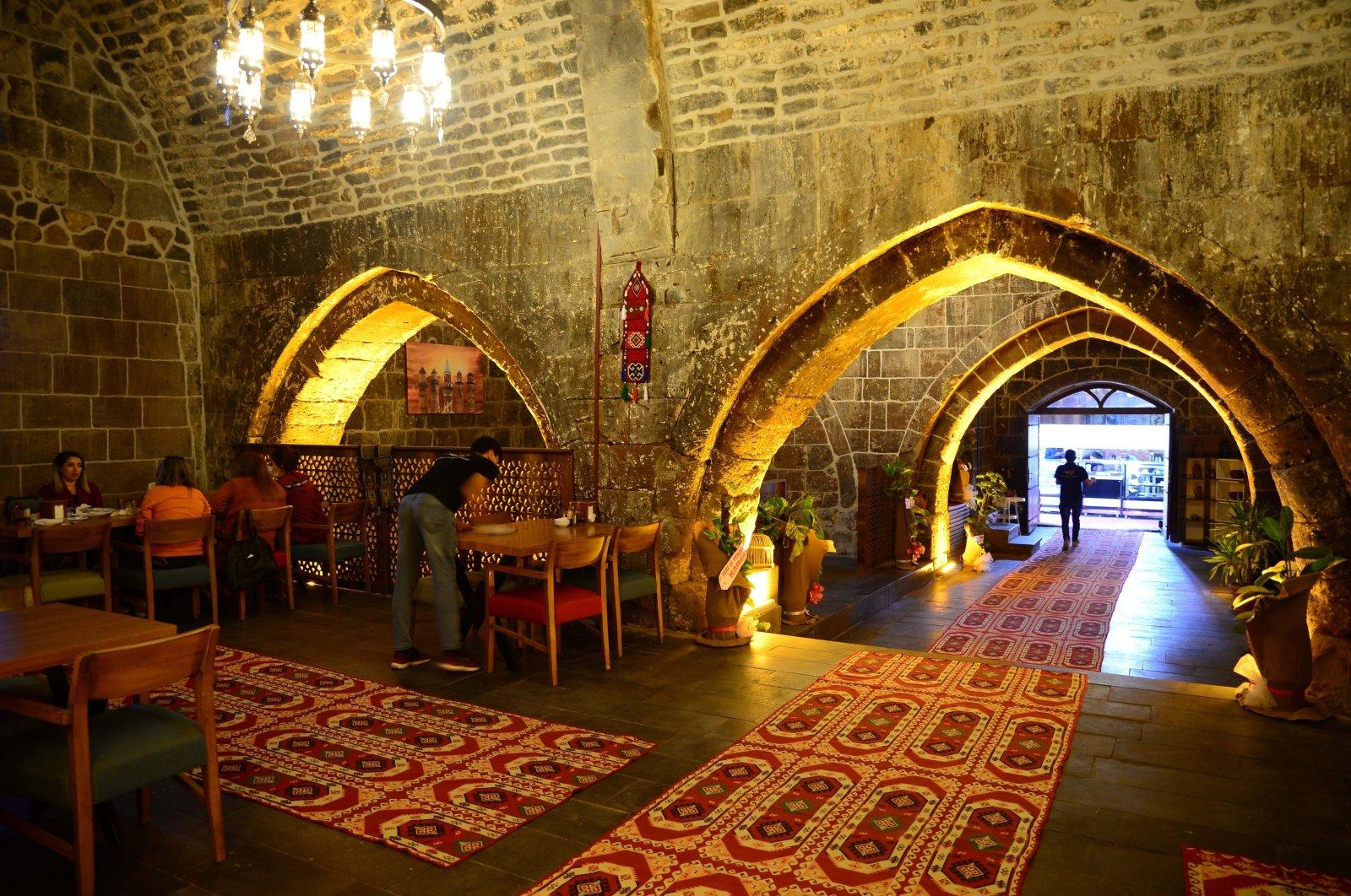 People enjoy local foods in the Başhan Inn, Bitlis, eastern Turkey, Nov. 5, 2020. (AA Photo)