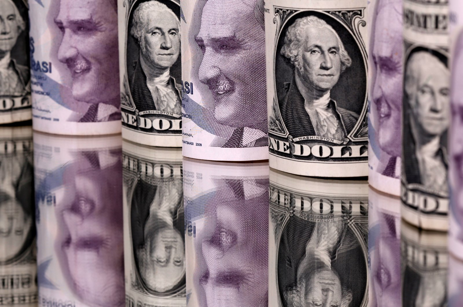 Turkish and U.S. currency is stacked side by side in this illustration taken on Jan. 6, 2020. (Reuters Photo)