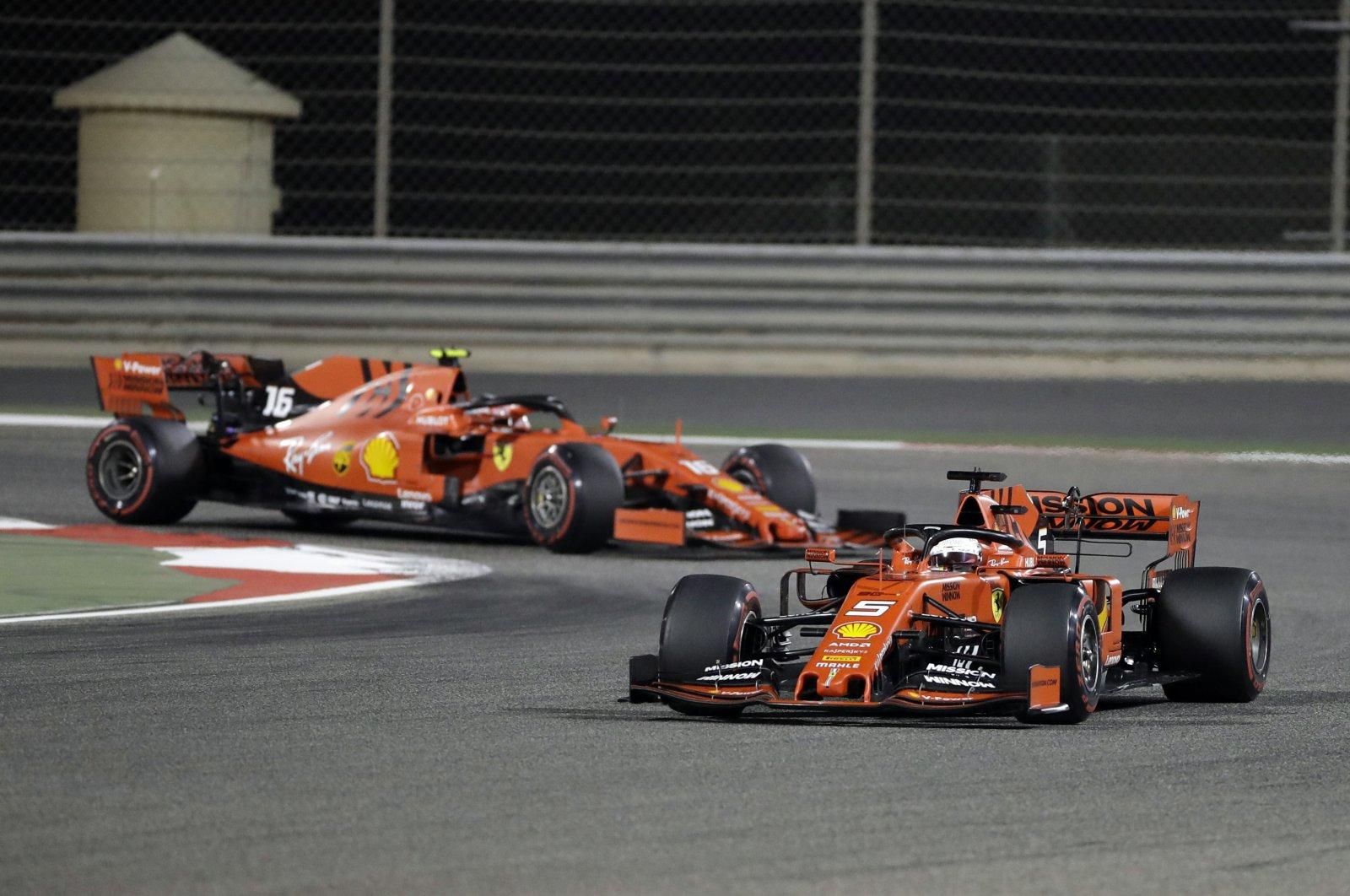 Ferrari driver Sebastian Vettel steers his car, followed by teammate Charles Leclerc behind, during the Bahrain F1 Grand Prix, in Sakhir, Bahrain, March 31, 2019. (AP Photo)