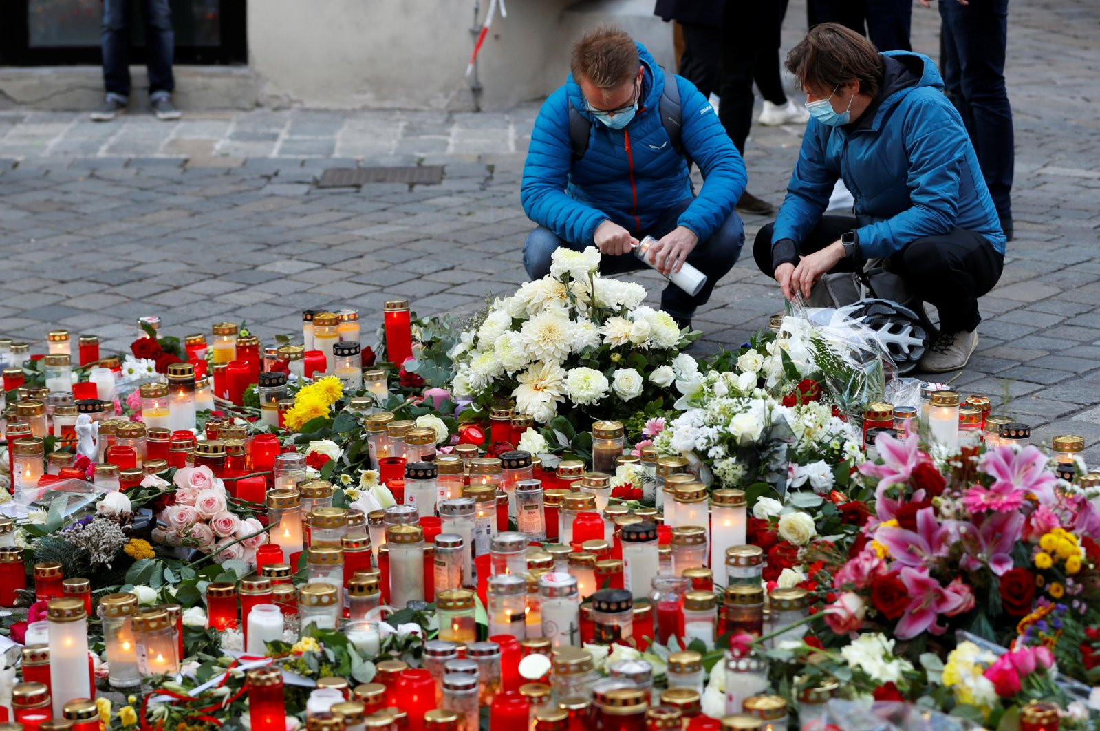 People pay their respects at the site of the Daesh terrorist attack in Vienna, Austria, Nov. 5, 2020. (Reuters Photo)