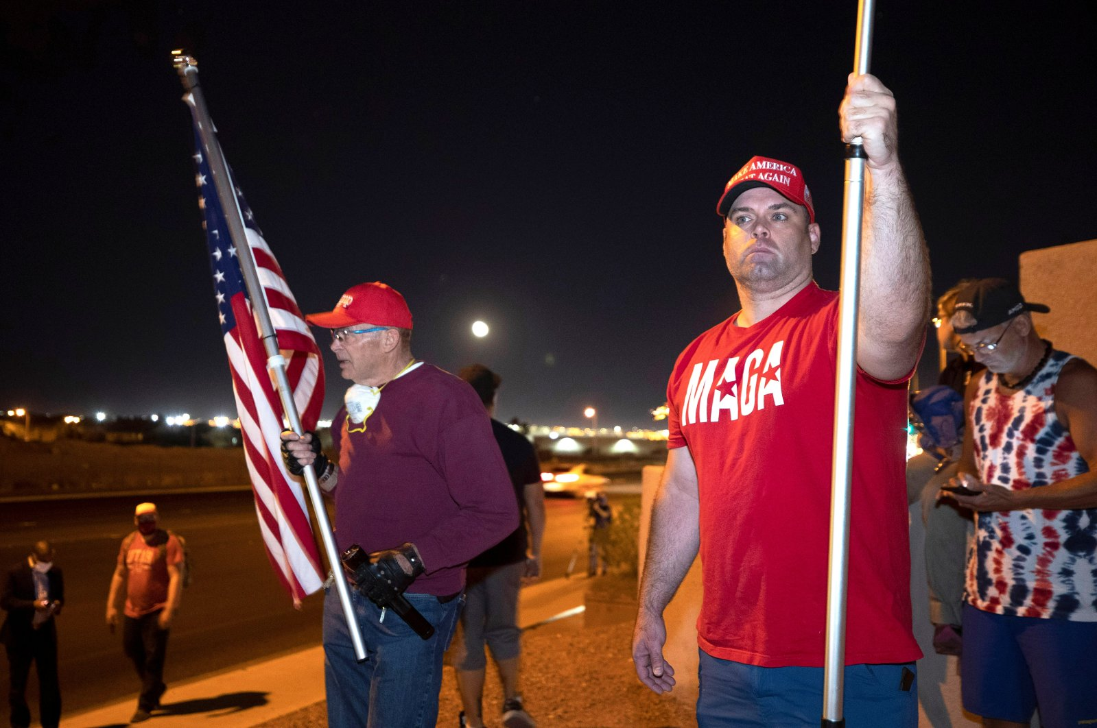 """William Carpenter (L) and Lance Baker, supporters of U.S. President Donald Trump, hold American flags during a """"Stop the Steal"""" protest at the Clark County Election Center in North Las Vegas, Nevada, U.S., Nov. 4, 2020. (Reuters Photo)"""
