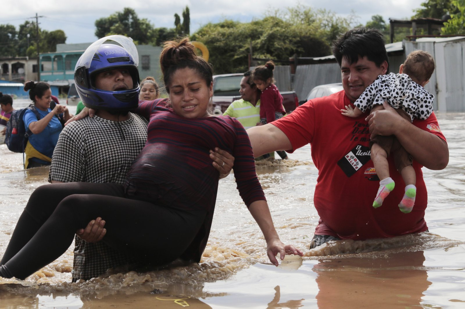 A pregnant woman is carried out of an area flooded by water brought by Hurricane Eta in Planeta, Honduras, Nov. 5, 2020. (AP Photo)