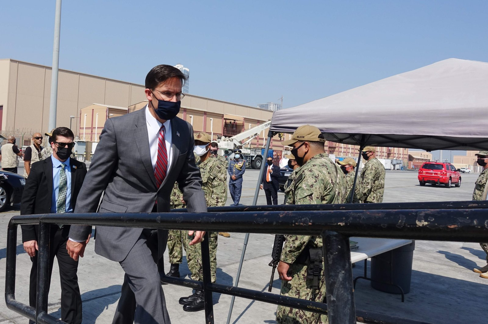 US Defense Secretary Mark Esper (C) boards on October 28, 2020 the USS Devastator minesweeper while on a visit to the Naval Forces Central Command base in the Gulf kingdom of Bahrain. (AFP Photo)