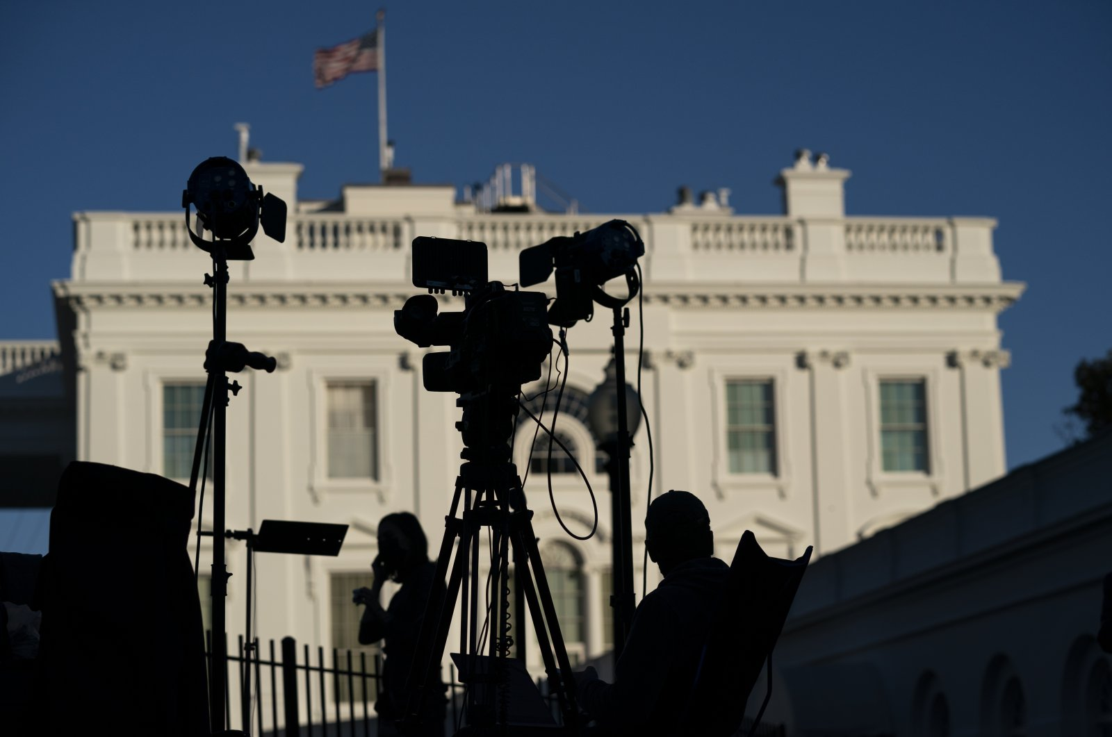Journalists gather outside the White House as Americans await the result of the U.S. presidential elections, in Washington, D.C., Nov. 4, 2020. (AP Photo)