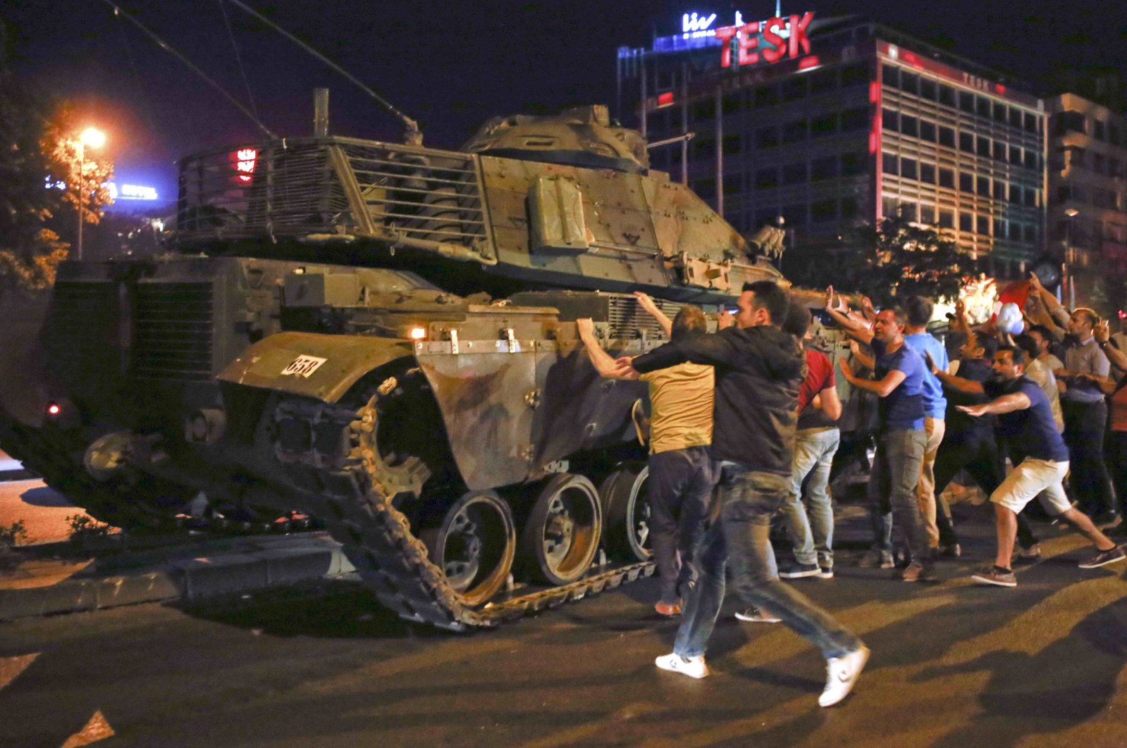 People try to stop a tank commanded by putschists during the coup attempt, in the capital Ankara, Turkey, July 16, 2016. (Reuters Photo)