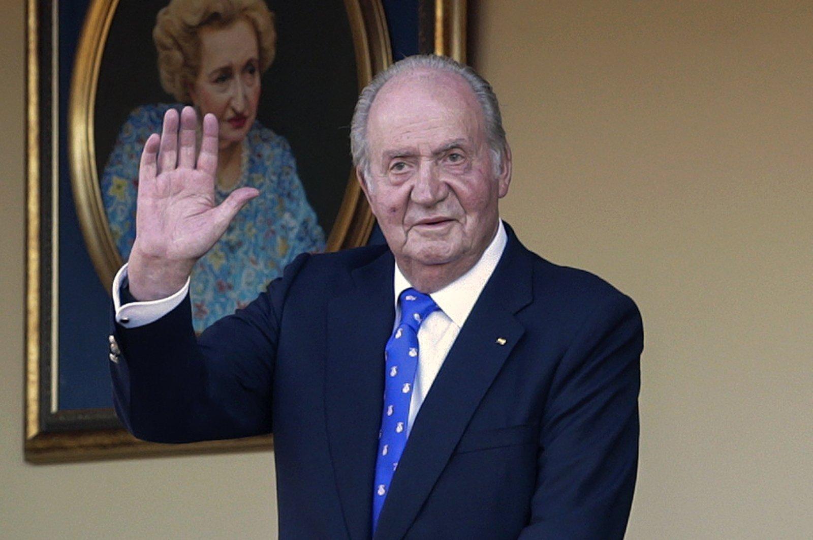 Spain's former King Juan Carlos waves during a bullfight at the bullring in Aranjuez, Madrid, Spain, June 2, 2019. (AP Photo)