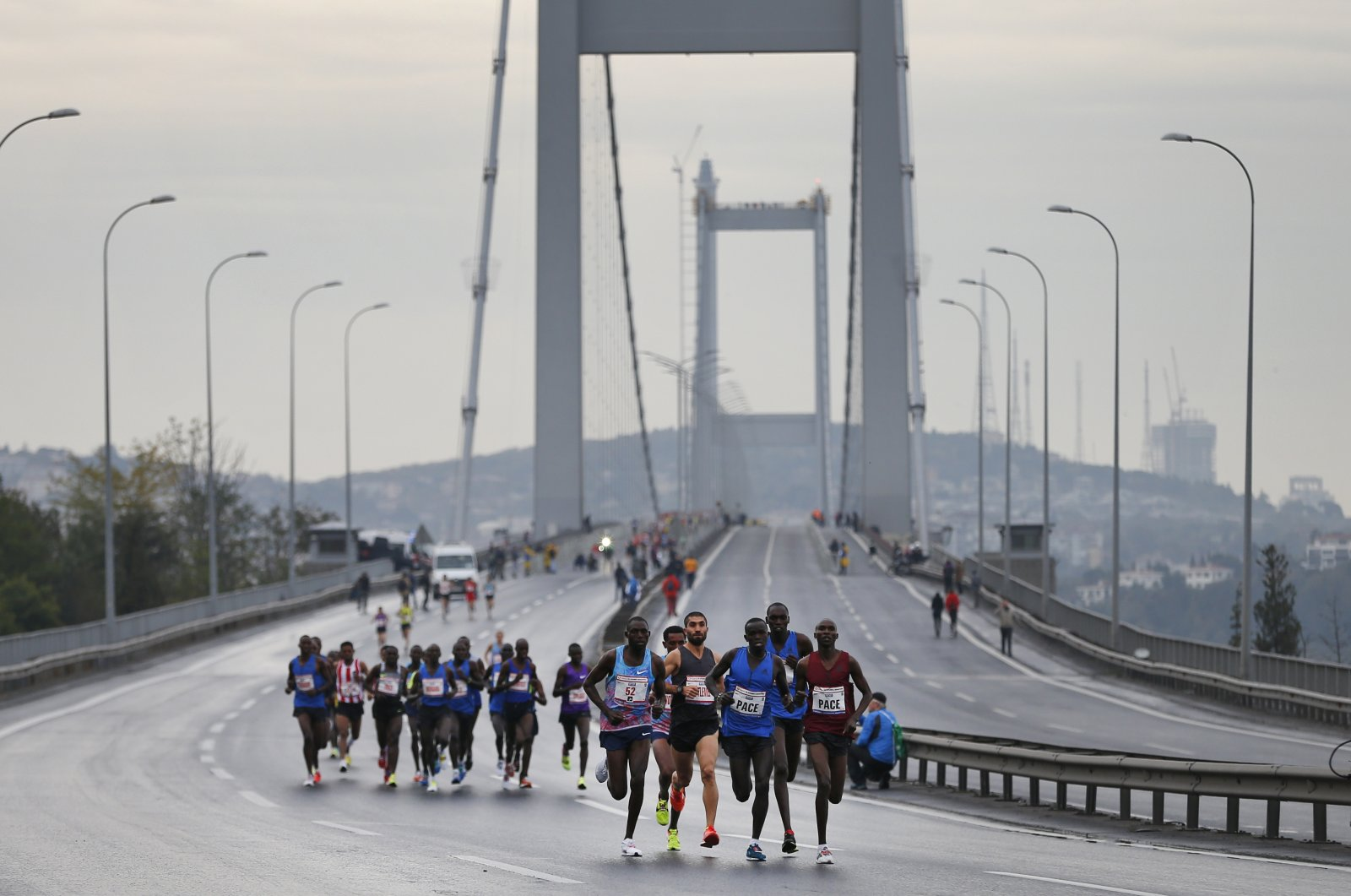 Athletes cross the July 15th Martyrs' Bridge during the Istanbul Marathon, in Istanbul, Turkey, Nov. 12, 2017. (AP Photo)
