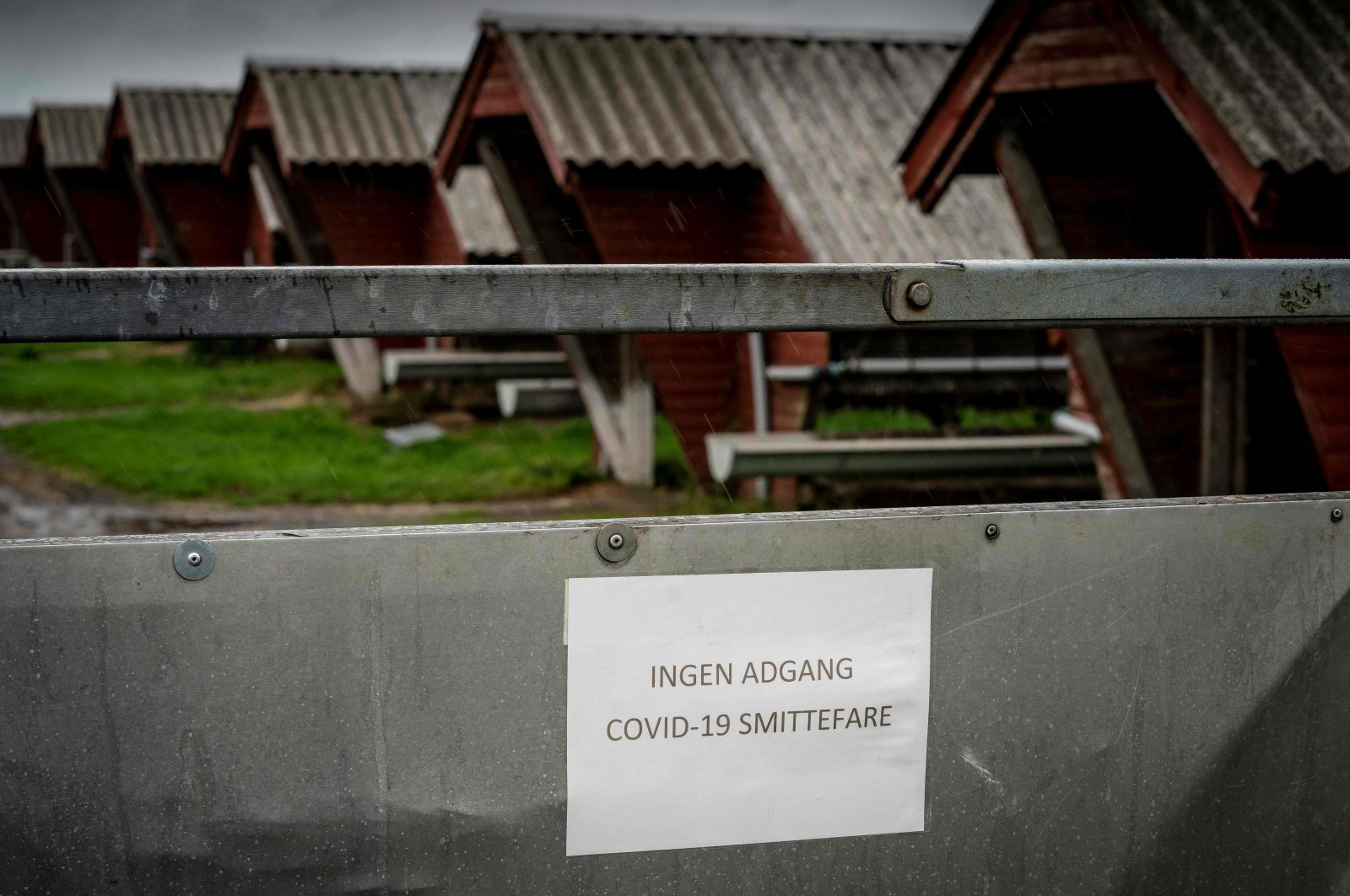 """A sign in Danish language reads """"No access – risk of Covid-19 infection"""" at a minks farm in Hjorring, in North Jutland, Denmark, Oct. 8, 2020. (AFP Photo)"""