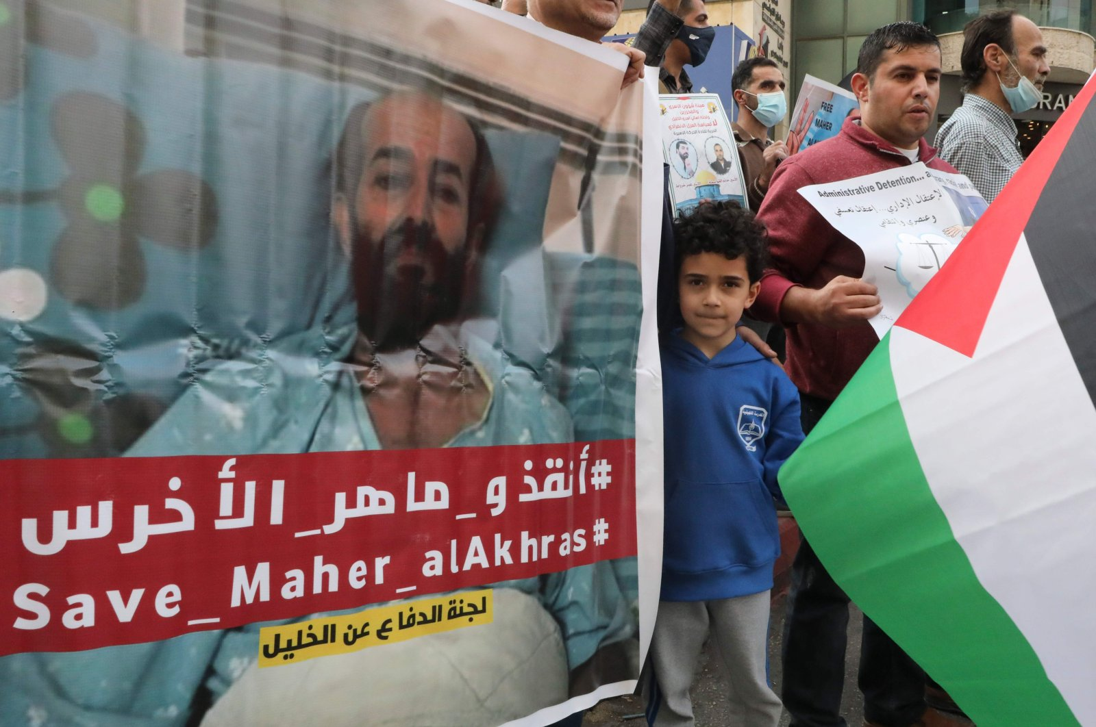 Palestinians carry placards demanding the release of administrative detainee, Maher al-Akhras, from Israeli custody during a demonstration after his health has deteriorated while on hunger strike for nearly 100 days, Hebron, Palestine, Nov. 3, 2020. (AFP Photo)