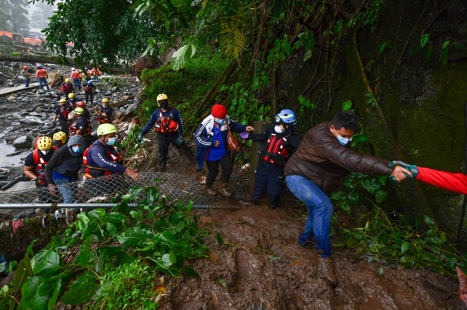 Members of the Red Cross help to evacuate people after the overflow of the Bambito river due to the heavy rains caused by Hurricane Eta, now degraded to a tropical storm, in Bambito, Chiriqui Province, Panama, Nov. 5, 2020. (AFP Photo)
