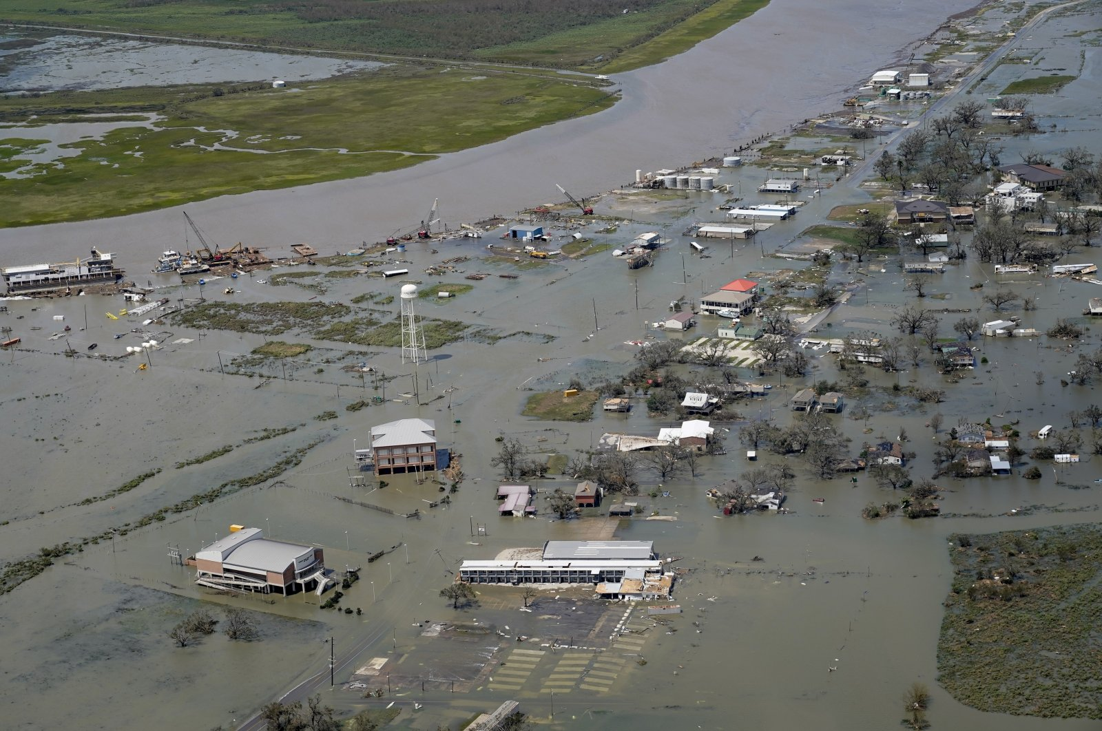 Buildings and homes are flooded in the aftermath of Hurricane Laura in Cameron, La. Laura, which jumped 65 mph (105 kph) in the day before landfall, tied the record for the biggest rapid intensification in the Gulf of Mexico on Aug. 27, 2020 (AP File Photo)