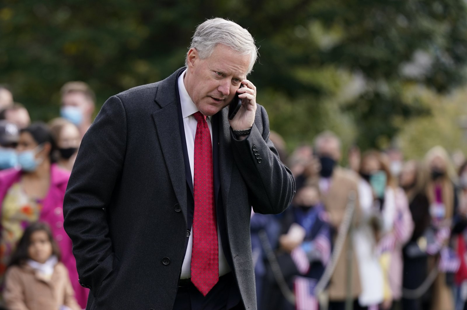 White House chief of staff Mark Meadows speaks on a phone on the South Lawn of the White House in Washington, Oct. 30, 2020. (AP Photo)