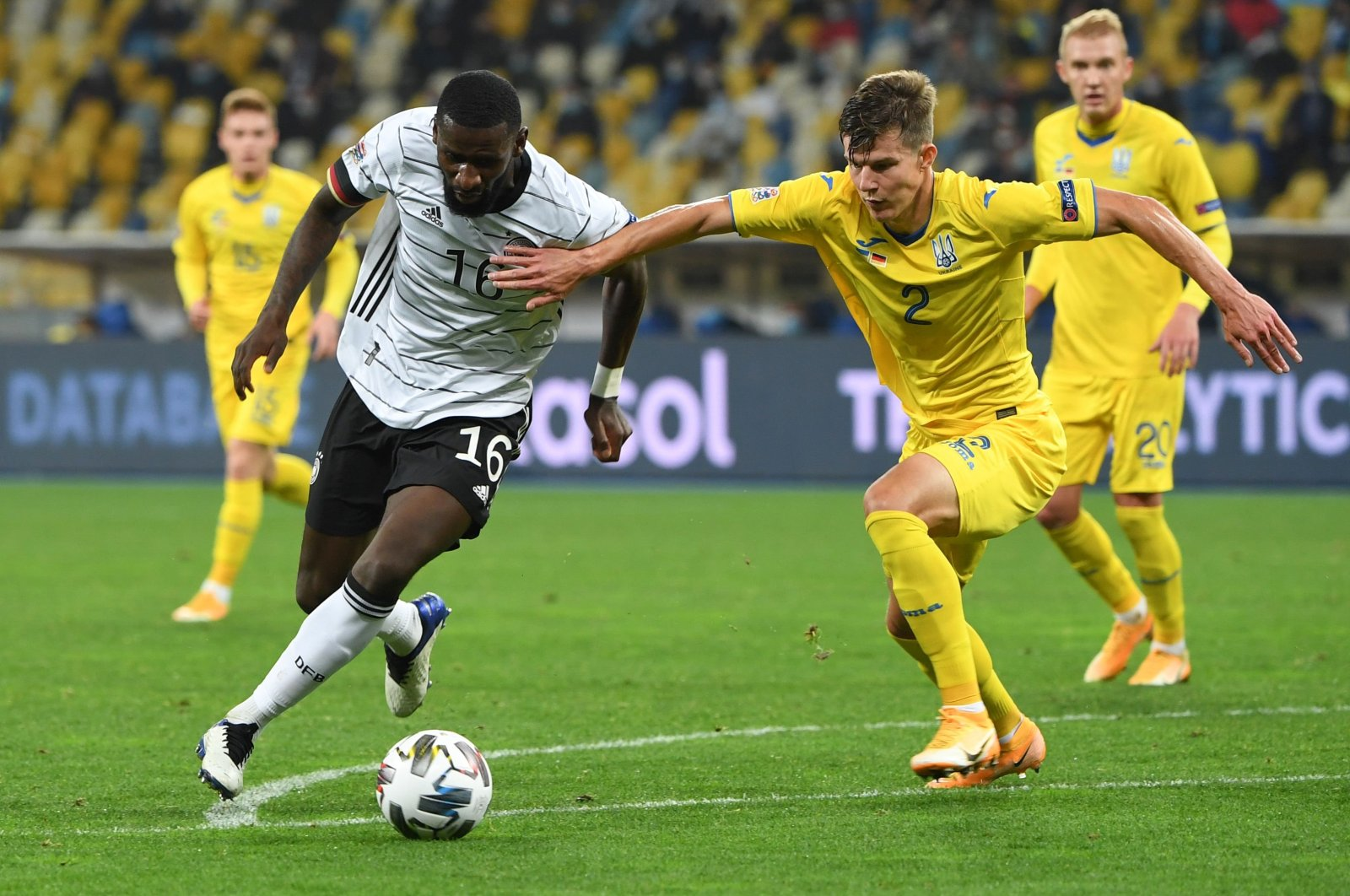 Germany's defender Antonio Rudiger (L) and Ukraine's defender Eduard Sobol vie for the ball during the UEFA Nations League football match between Ukraine and Germany at Olympiyskiy National Sports Complex in Kyiv, Ukraine, Oct. 10, 2020. (AFP Photo)