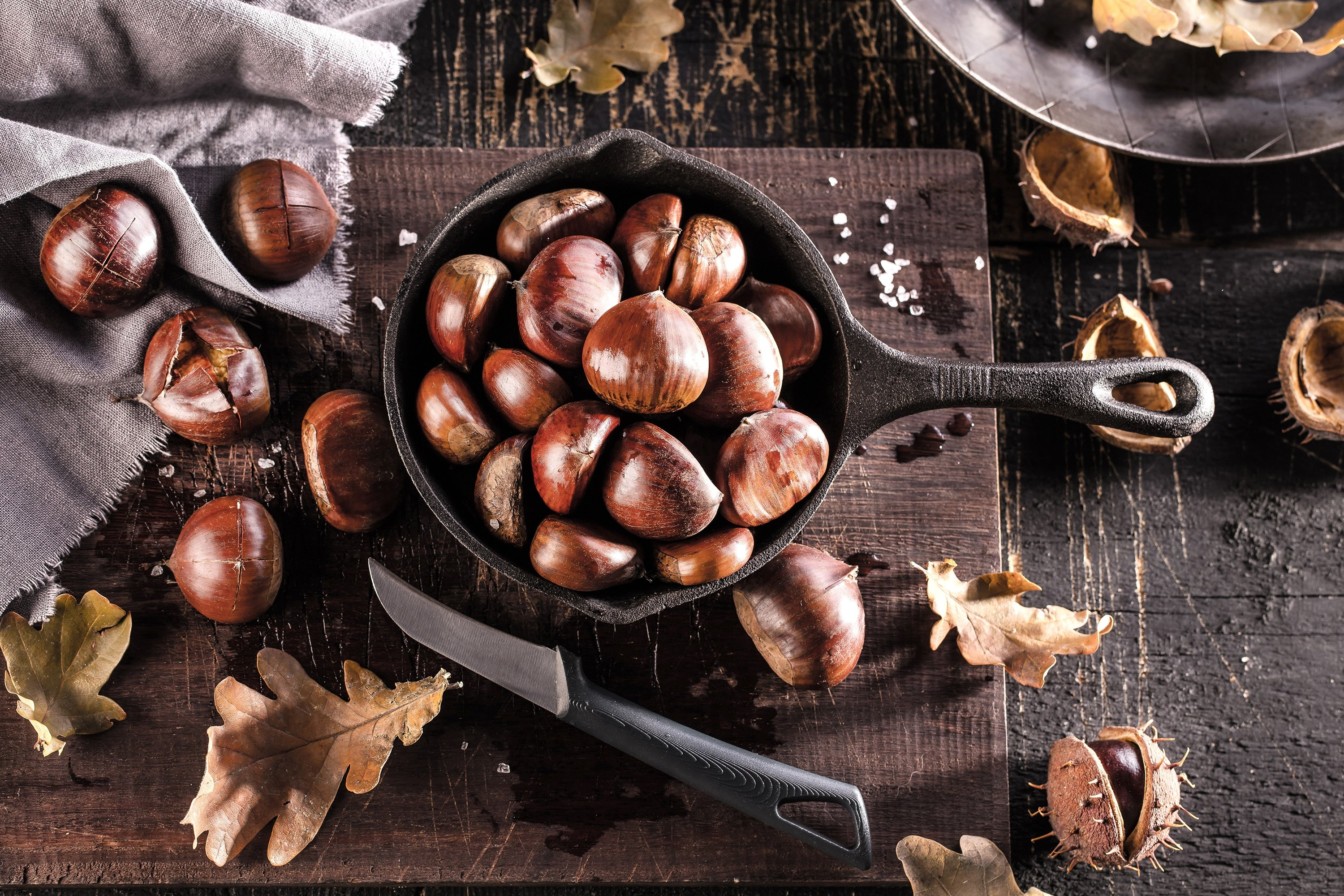 Make sure to cut the hard peel of chestnuts before roasting them to prevent them from exploding. (Shutterstock Photo)