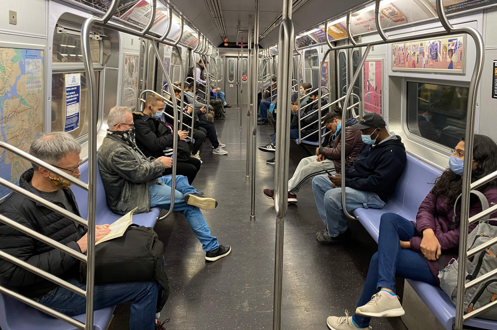 Commuters ride the subway, New York City, Nov. 5, 2020. (AFP Photo)