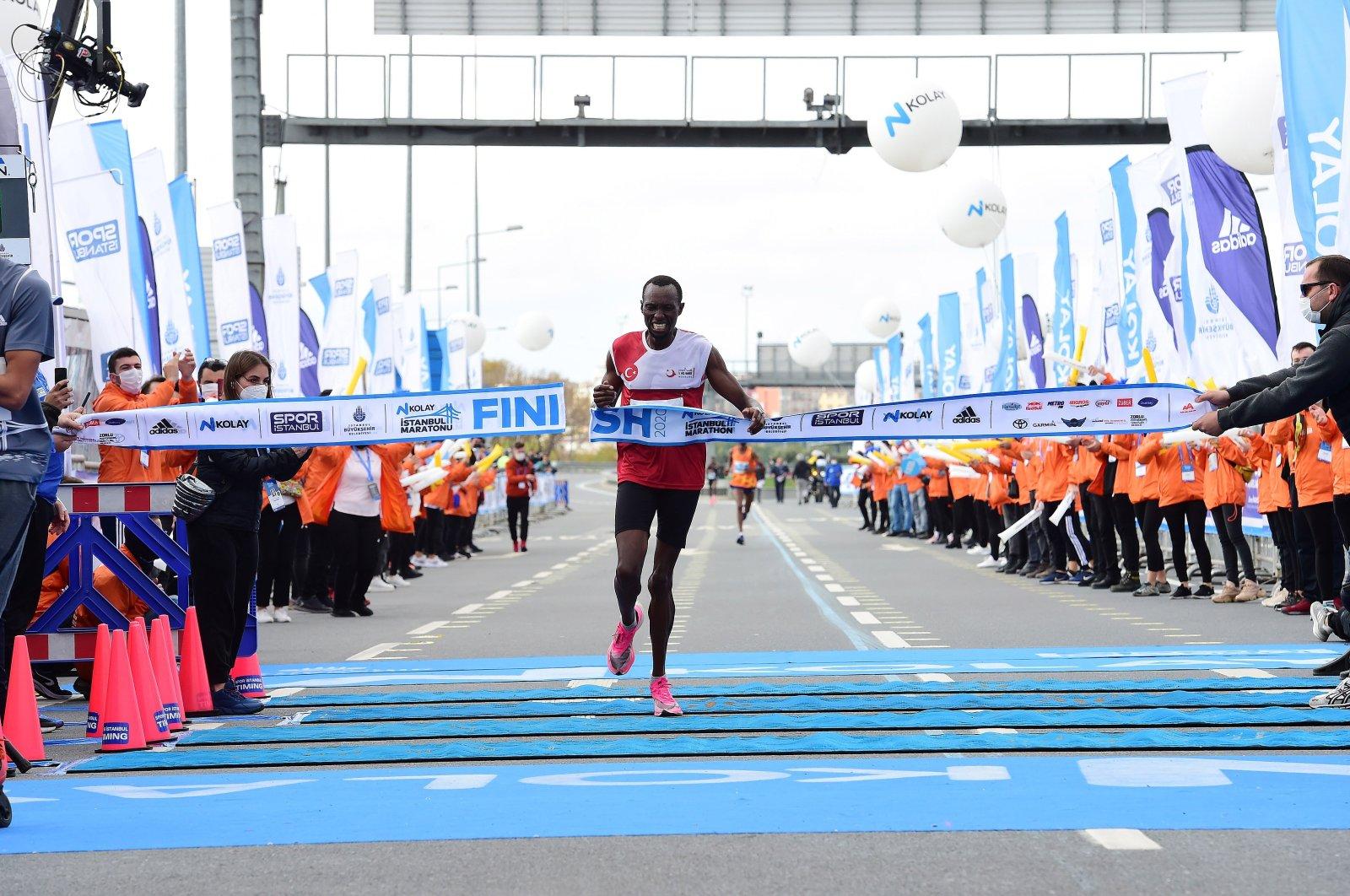 Benard Cheruiyot Sang, winner of the marathon in the men's category, arrives at the finish line, in Istanbul, Turkey, Nov. 8, 2020.  (İHA Photo)