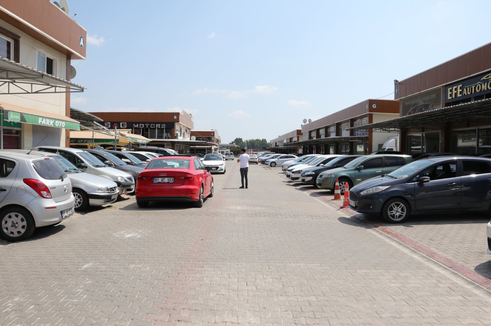 Cars are seen in front of dealerships in the southern city of Adana, Turkey, Aug. 12, 2020. (IHA Photo)