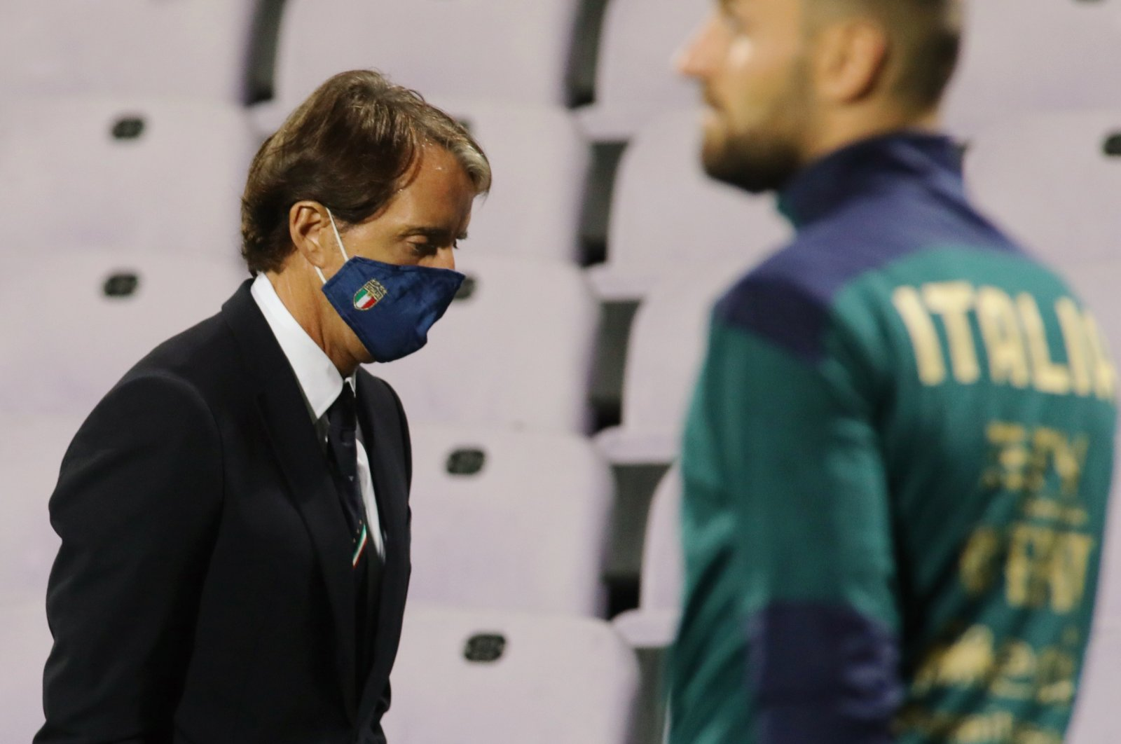 Italy's coach Roberto Mancini wears a face mask during a game against Moldova, in Florence, Italy, Oct. 7, 2020. (AP Photo)