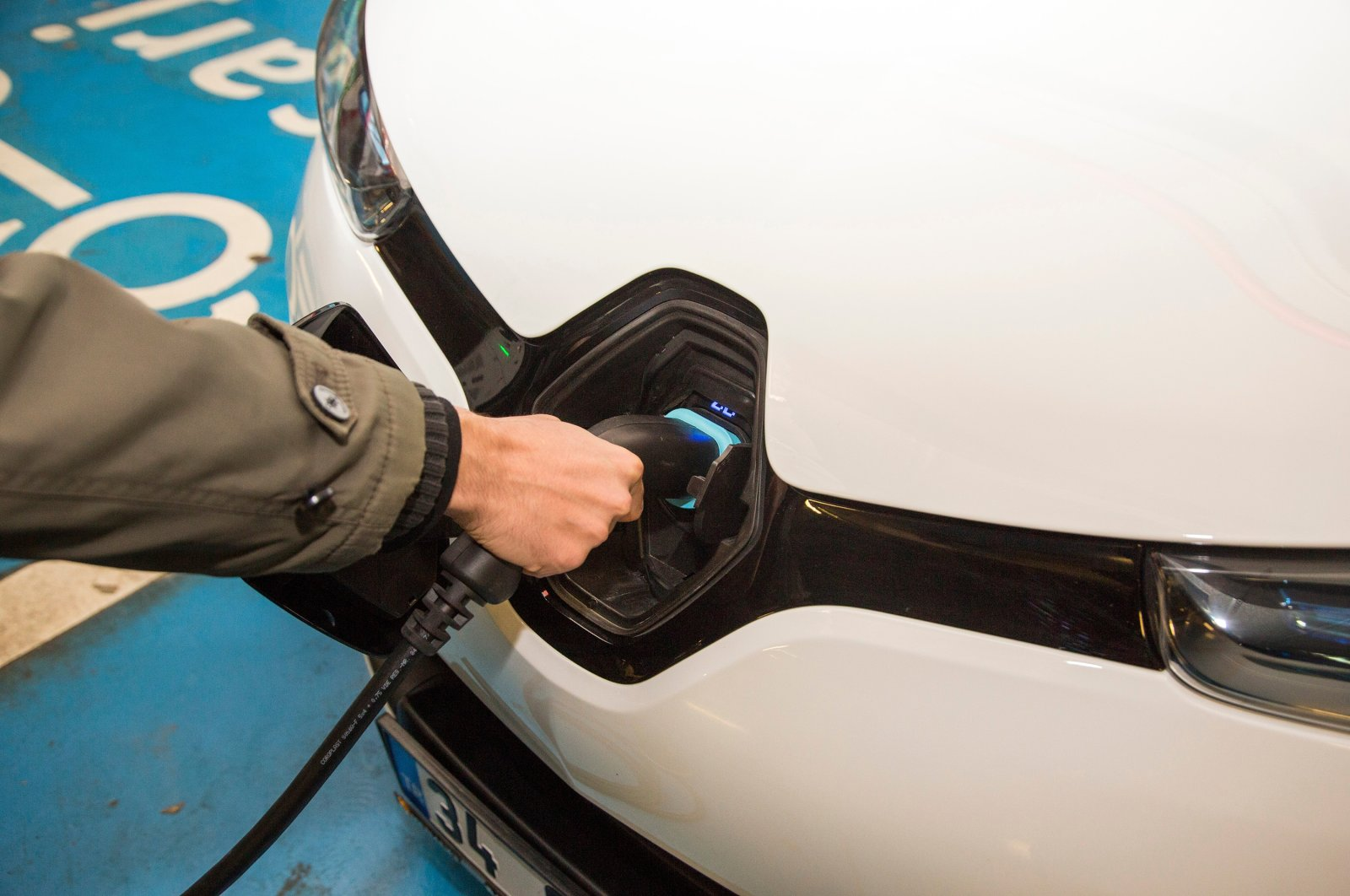 An electric car is charged at a charging station in Istanbul, Turkey, Dec. 13, 2017. (Shutterstock Photo)