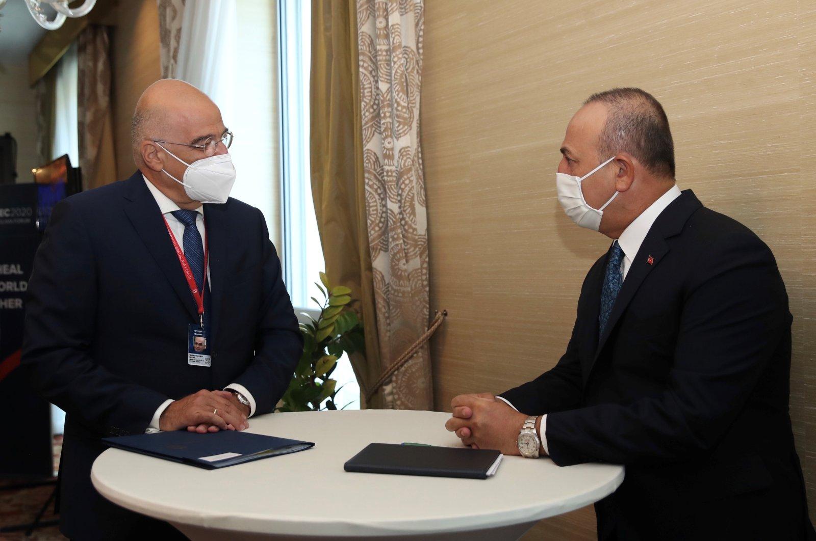 Foreign Minister Mevlüt Çavuşoğlu meets with his Greek counterpart Nikos Dendias on the sidelines of the Global Security Forum in Bratislava, Slovakia, Oct. 8, 2020. (Turkish MFA via Reuters)