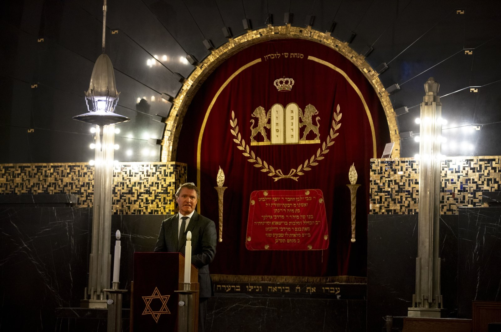 Rene de Reuver, speaking on behalf of the General Synod of the Protestant Church in the Netherlands, reads a statement at the Rav Aron Schuster Synagogue in Amsterdam, Netherlands, Nov. 8, 2020. (AP Photo)