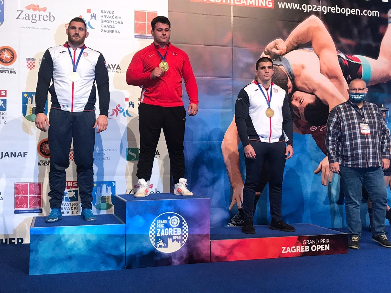 Turkish wrestler Rıza Kayaalp (C) poses with his gold medal in Zagreb, Croatia, Nov. 8, 2020. (AA Photo)