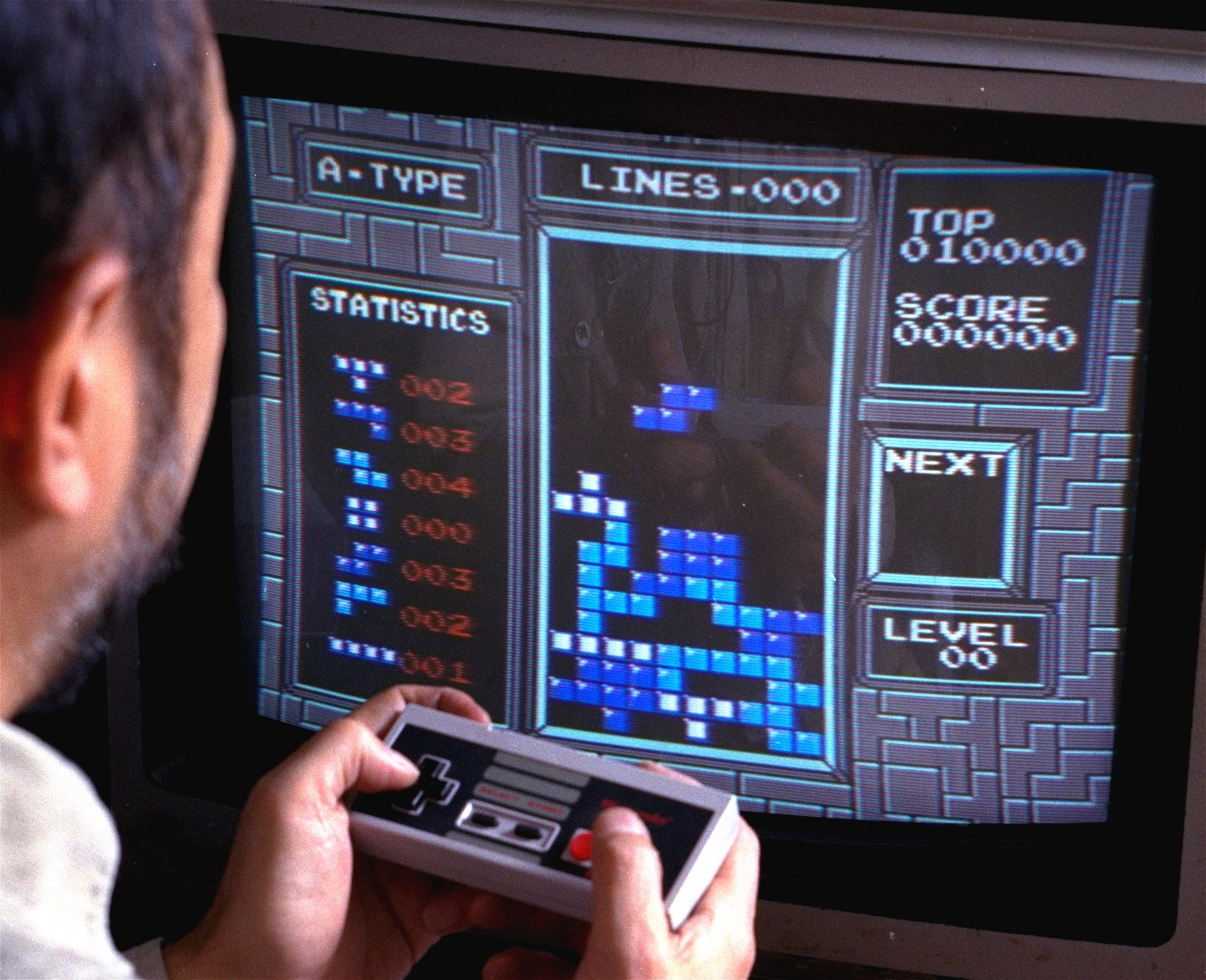 In this June 1990 file photo, Tetris, an addictive brain-teasing video game, is shown as played on the Nintendo Entertainment System in New York. (AP Photo)