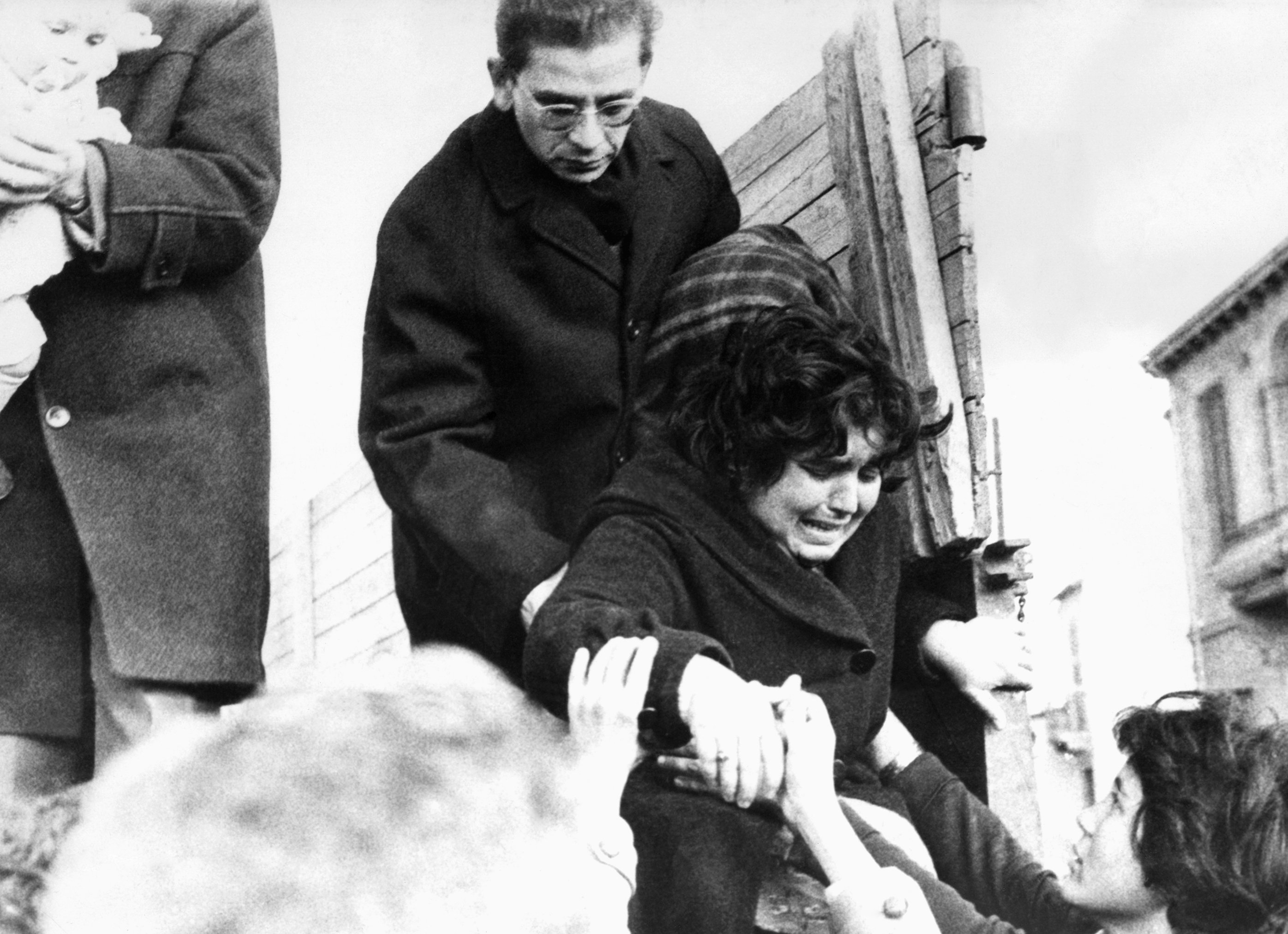 A crying Turkish Cypriot woman inhabitant of the Nicosia suburb of Kaimakli (Kaymaklı) is helped down from a lorry after the Turkish Cypriots in the district had evacuated their homes on Dec. 27, 1963 to seek safe refuge in the border of the Greek and Turkish quarter of the city. (AP Photo)