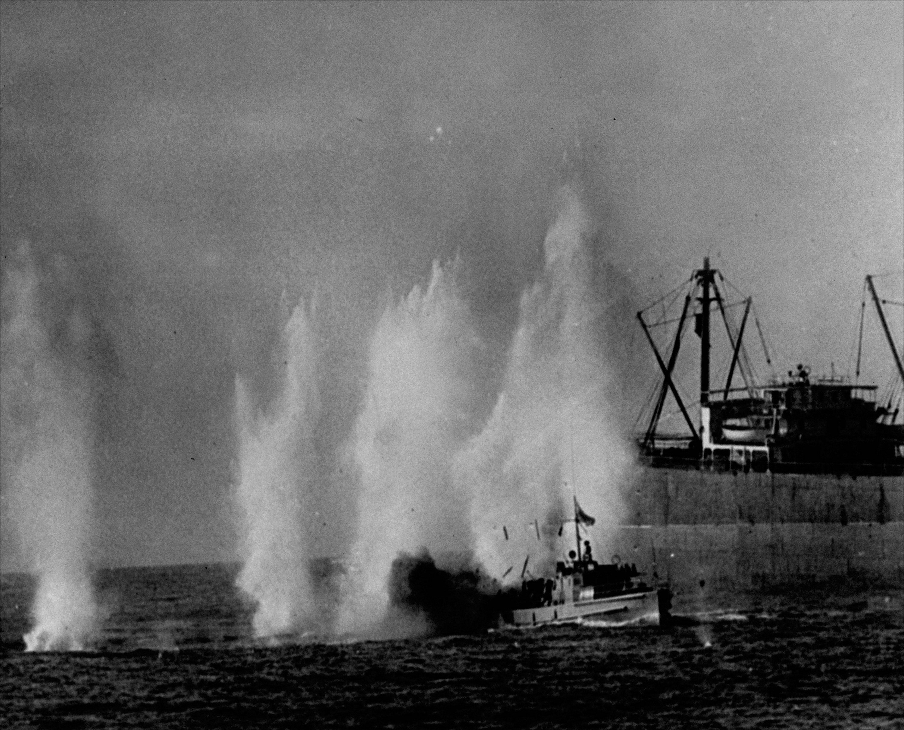 Rocket bursts erupt around a Greek Cypriot patrol boat in Xeros Harbor August 8, 1964, as a Turkish air force jet fighter attacked Greek Cypriot installations amid Turkey's bid to prevent the fall of Kokkina (Erenköy). Greek Cypriot President Archbishop Makarios threatened to attack every Turkish Cypriot village on the island August 9 unless Turkish attacks were halted. (AP Photo)