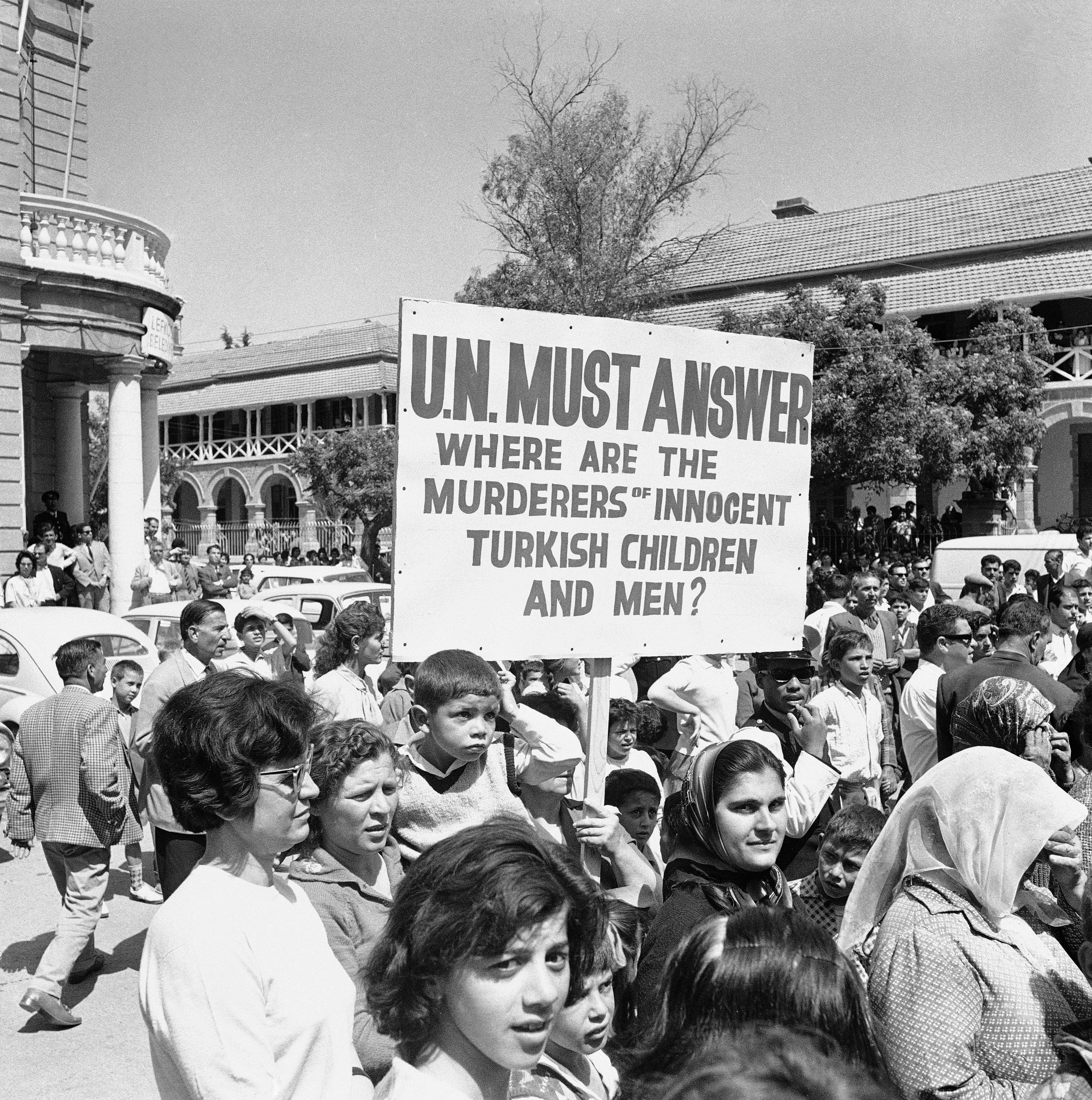 Women and children of Turkish Cypriot community gather in Nicosia's Atatürk Square during demonstration against United Nations on April 26, 1964 in Cyprus. Several thousands persons carrying signs marched through streets of the city calling for ouster of U.N. forces, on the island to end the communal fighting. (AP Photo)