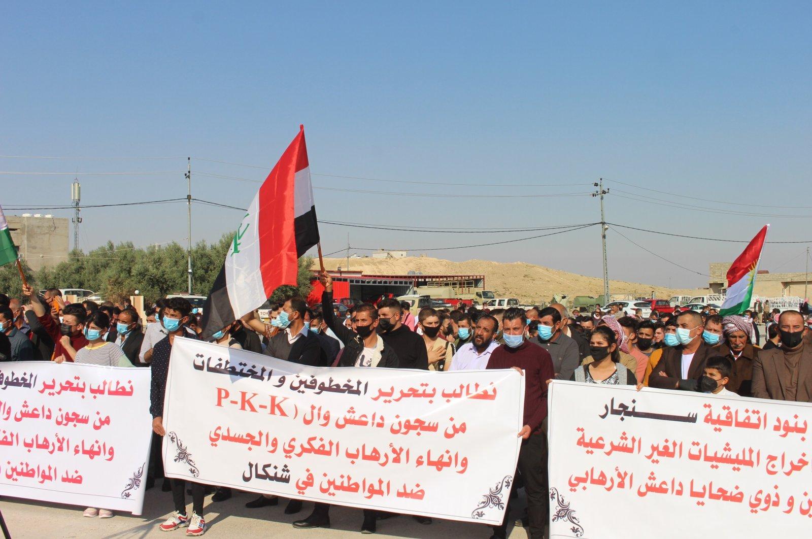 Yazidi people protest the PKK terrorist group's child recruitment, displacement policies in Sinjar, northern Iraq, Nov. 8, 2020 (AA Photo)