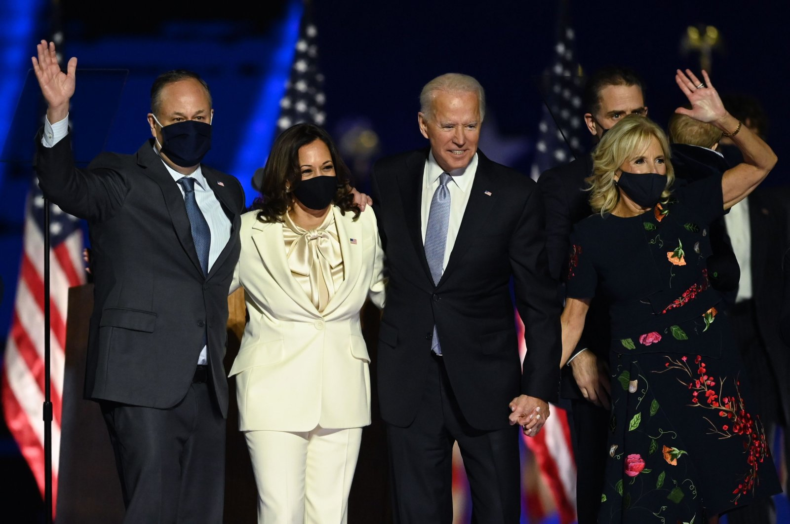 U.S. President-elect Joe Biden (2nd R) and Vice President-elect Kamala Harris (2nd L) stand with spouses Jill Biden (R) and Doug Emhoff (L) after delivering their first speech after the presidential victory, in Wilmington, Delaware, Nov. 7, 2020. (AFP Photo)